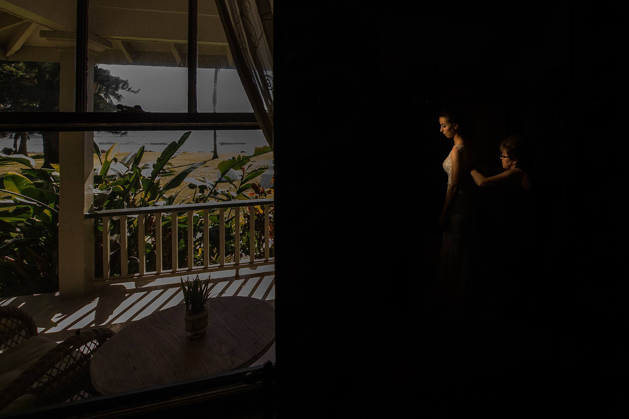 bride getting ready with dramatic lighting