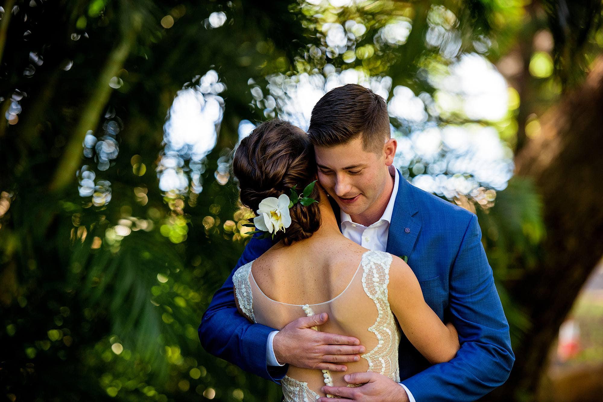 bride and groom embrace at olowalu plantation house