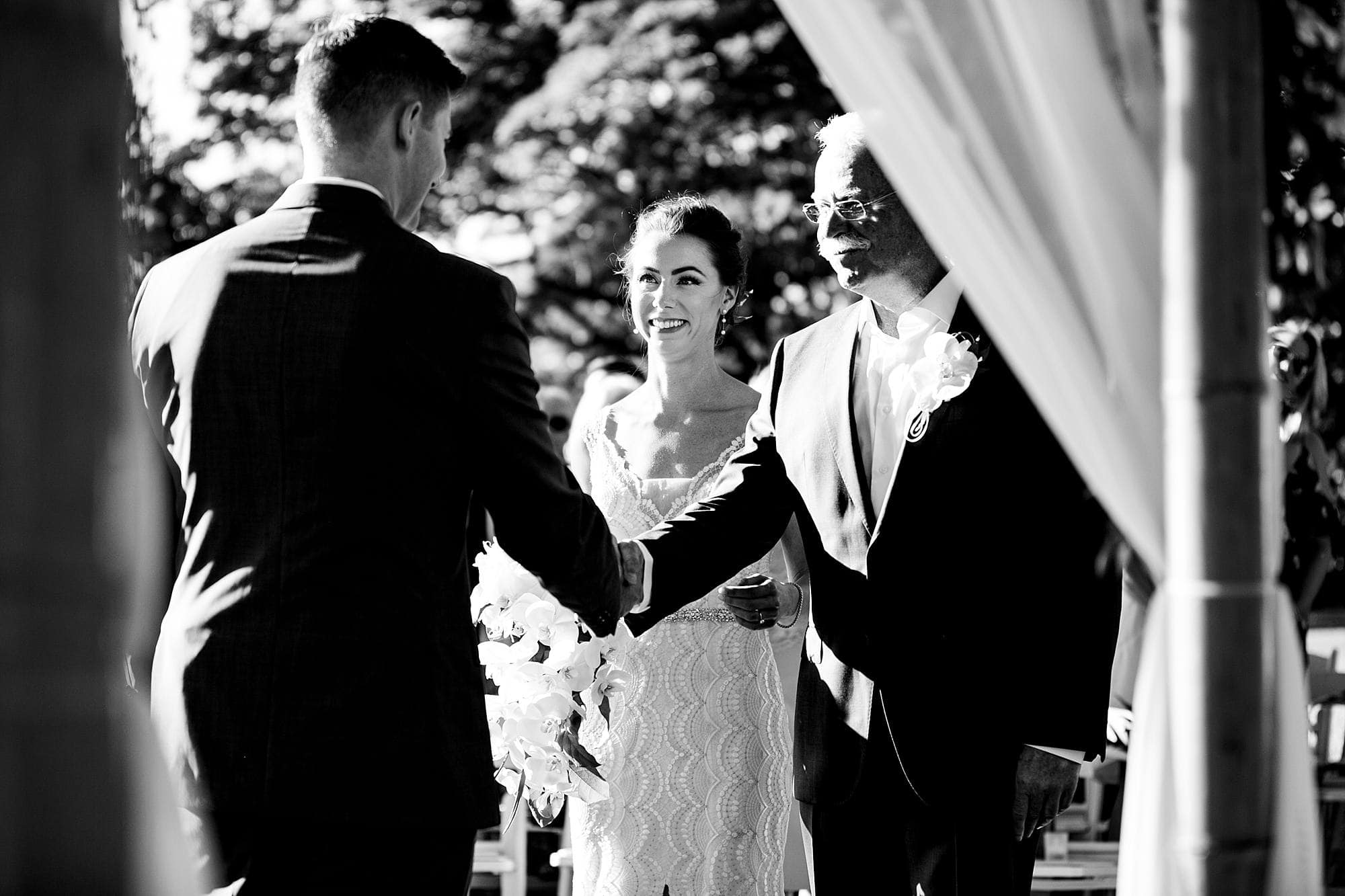 groom shaking father's hand at wedding