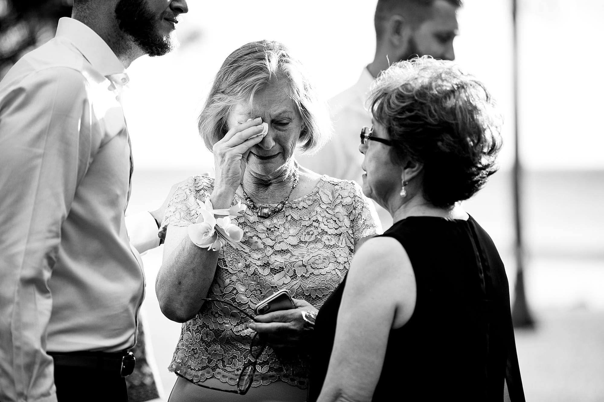 mother of the groom wiping tears