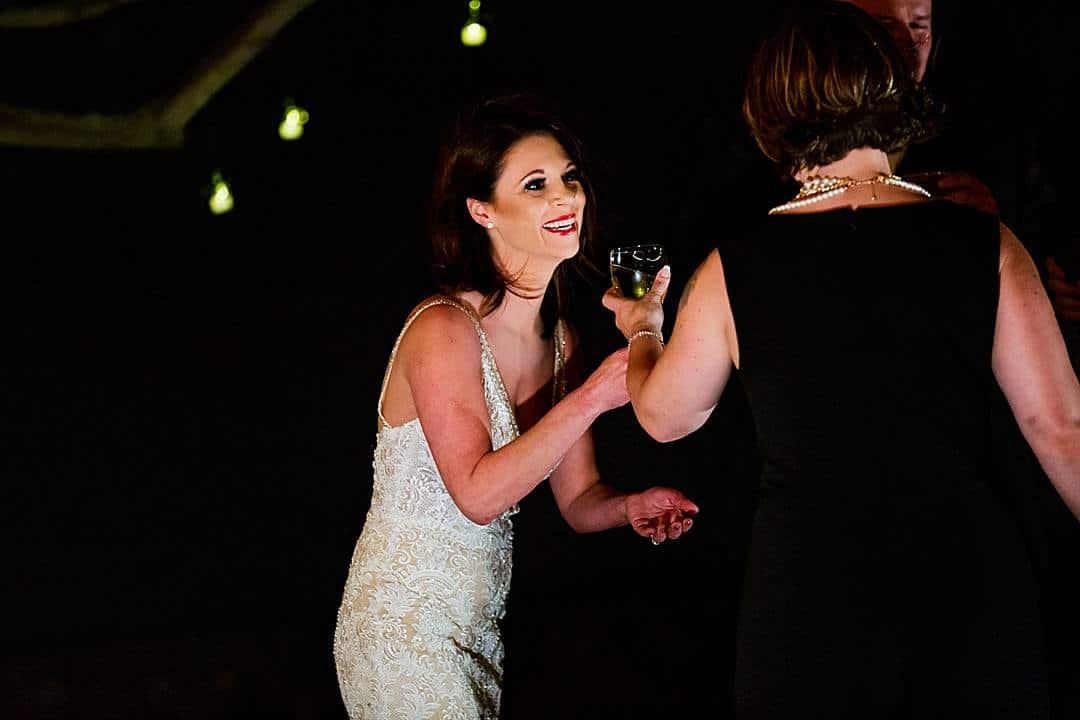 bride drinking wine during vows