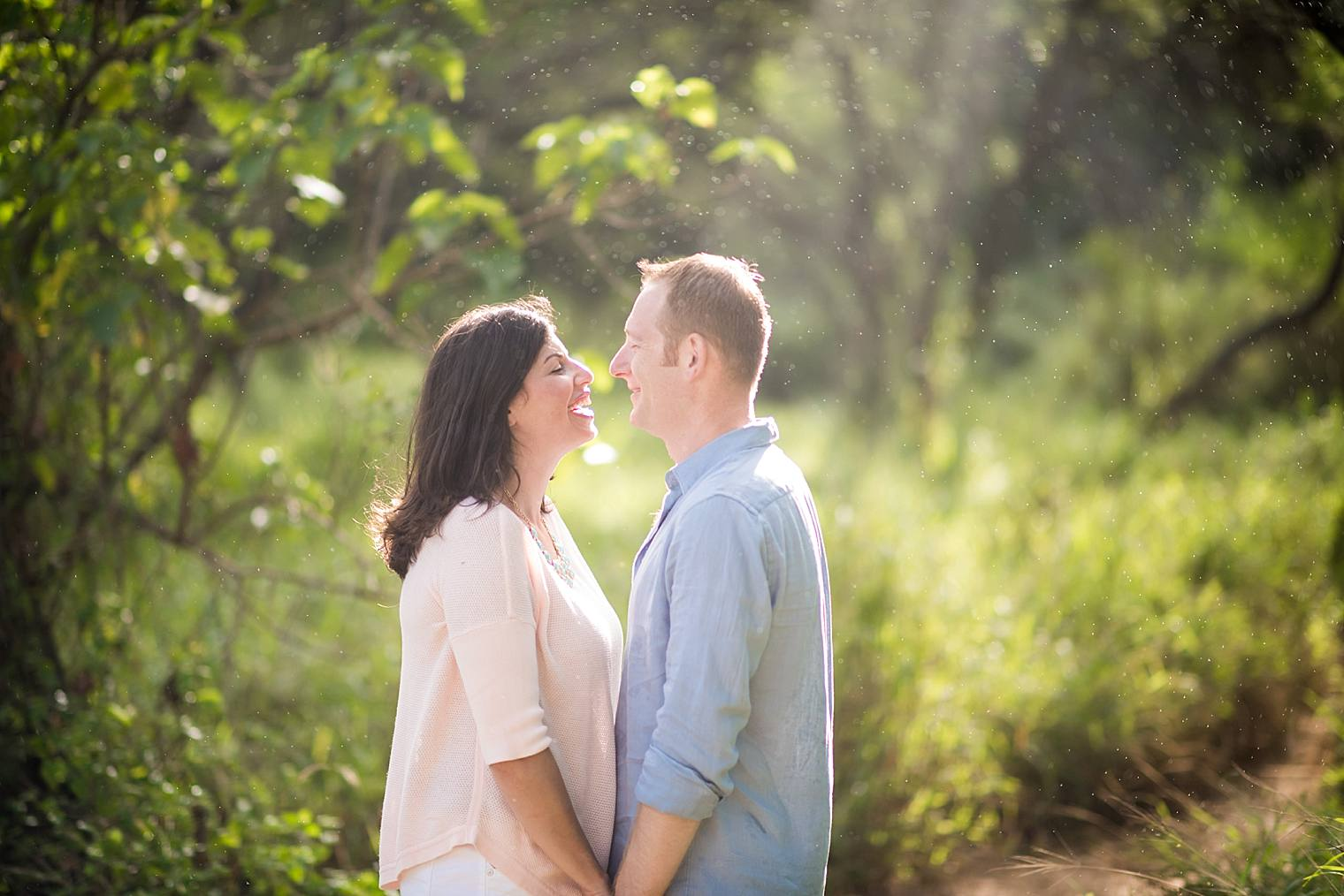 couple kissing during a sun shower