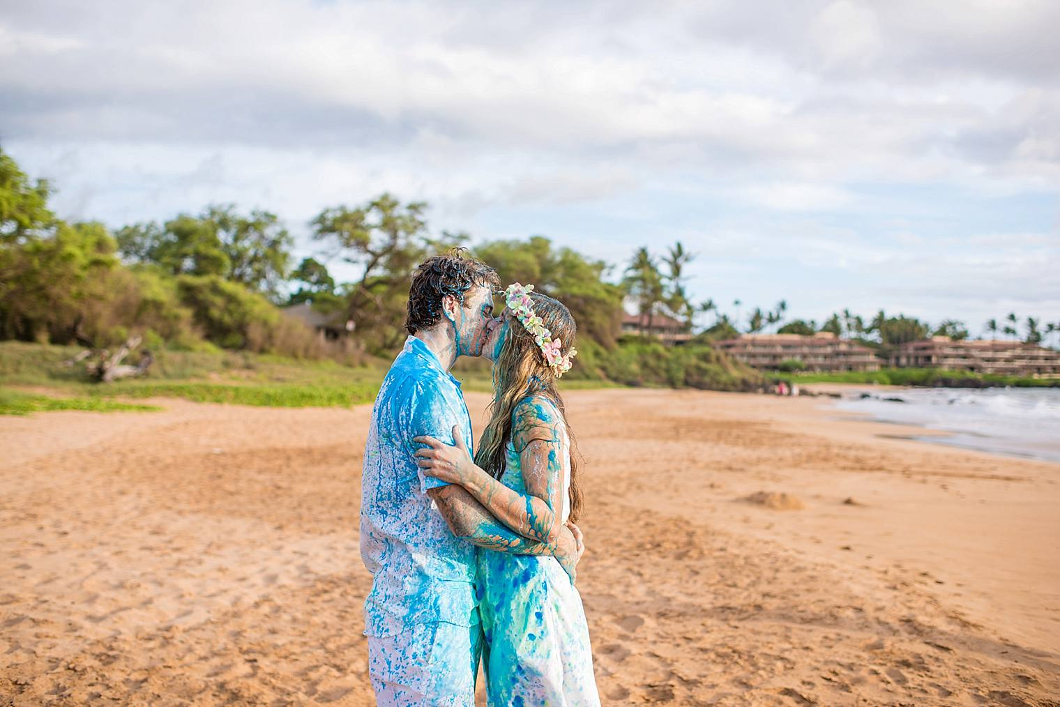 couple kissing after gender reveal