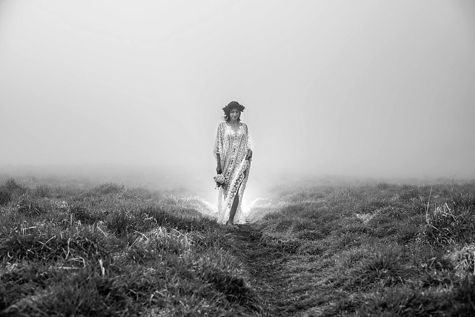 woman walking through the clouds in Haleakala