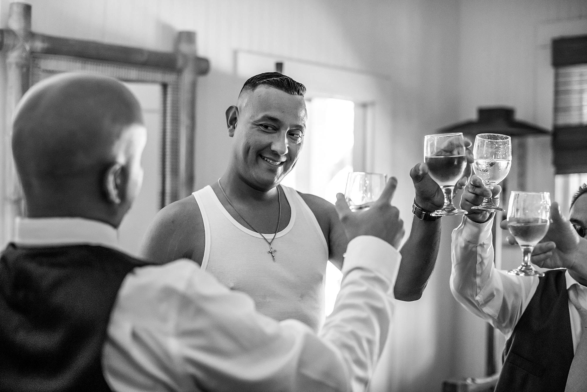 Man toasting before his maui wedding