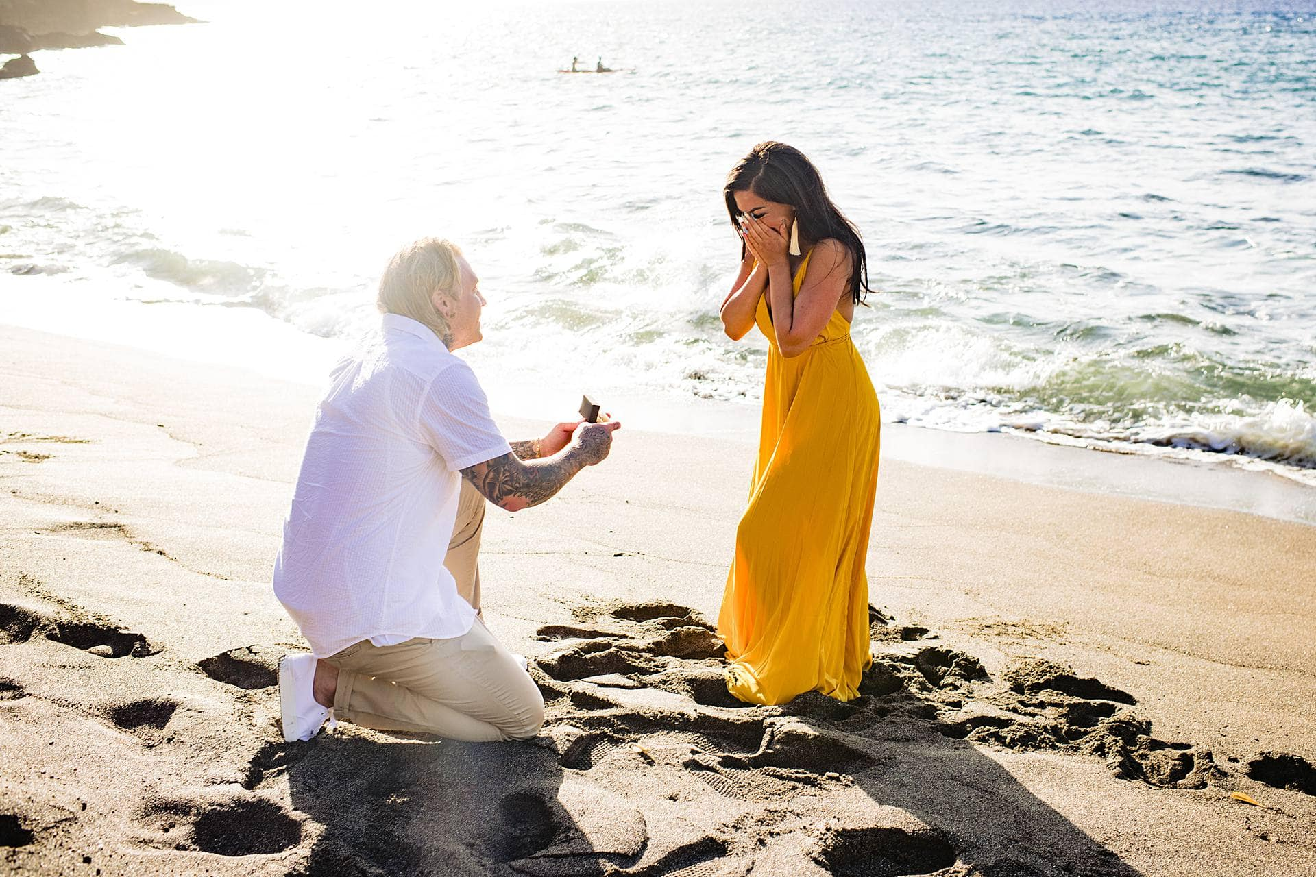 woman surprised by proposal in maui