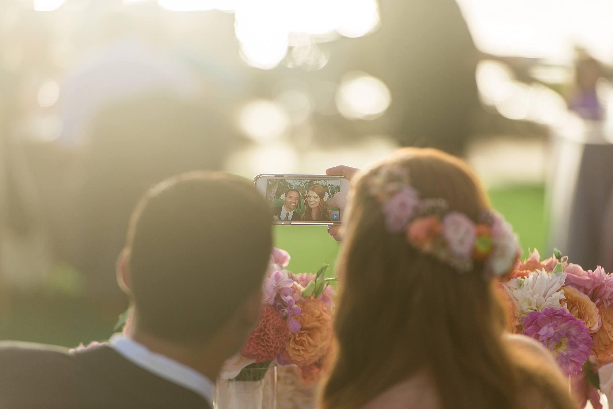 bride and groom taking selfie