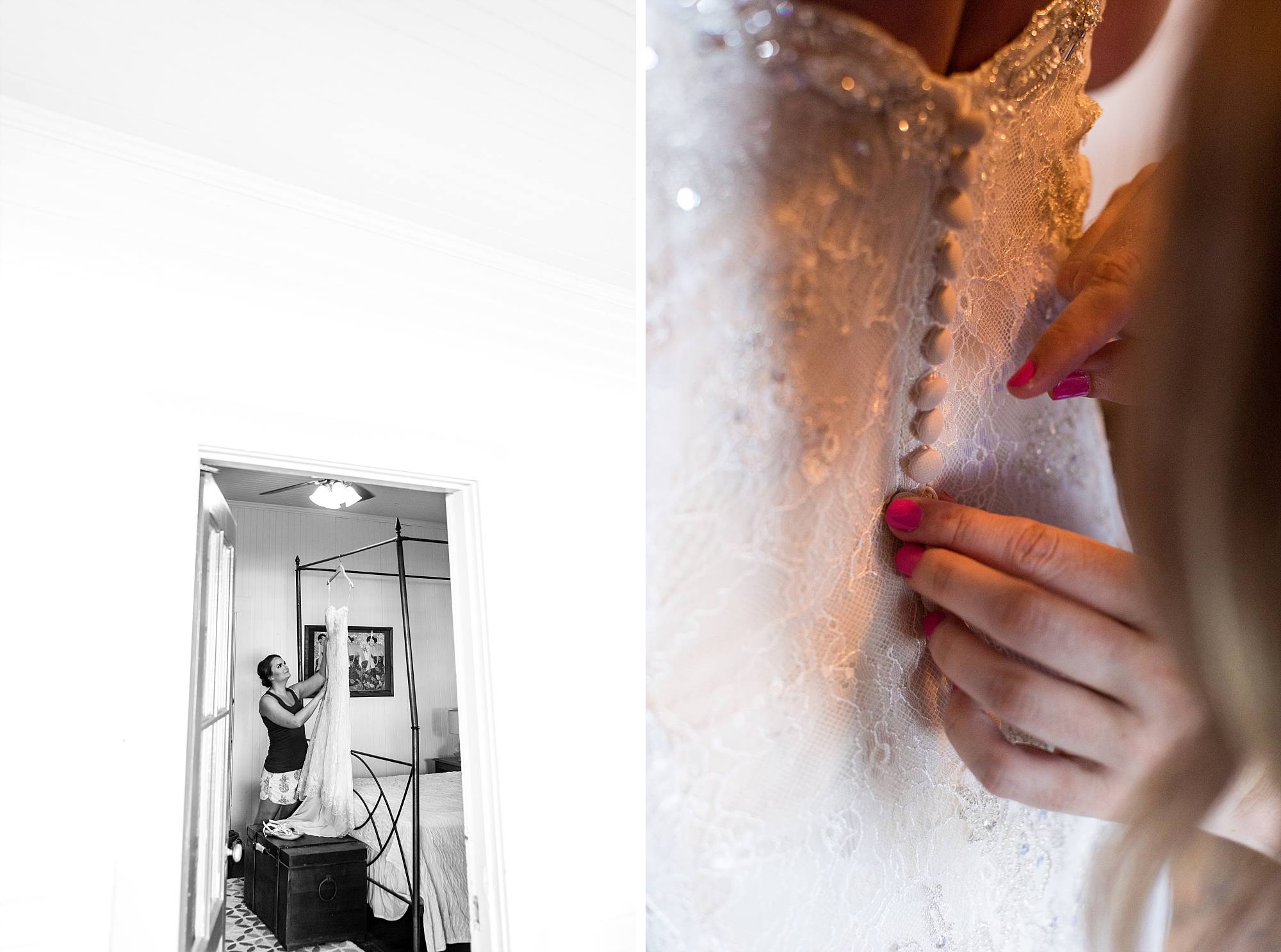 Bride getting ready to put dress on and buttoning up wedding dress