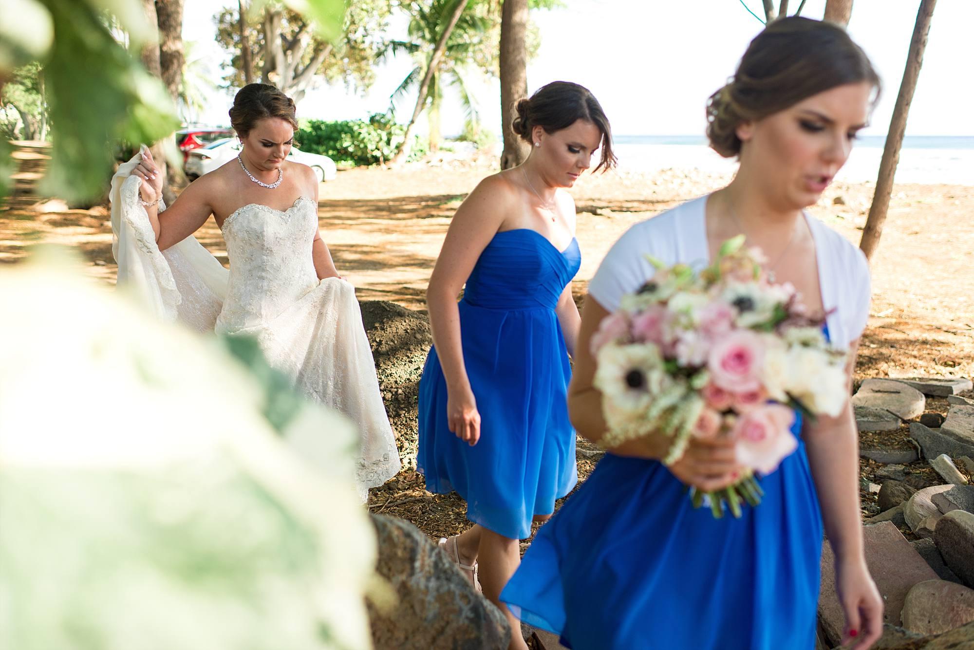 Bride and bridesmaids walking to ceremony