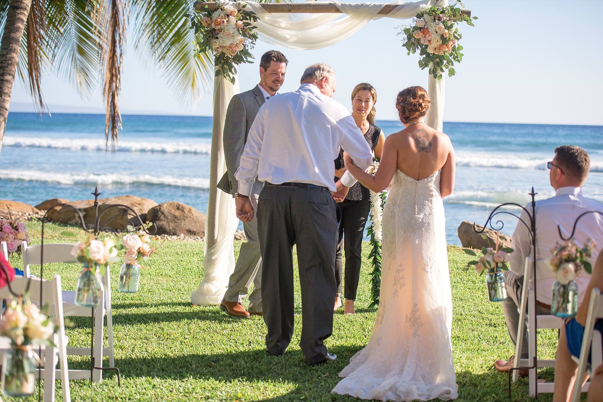 father escorting daughter to her groom