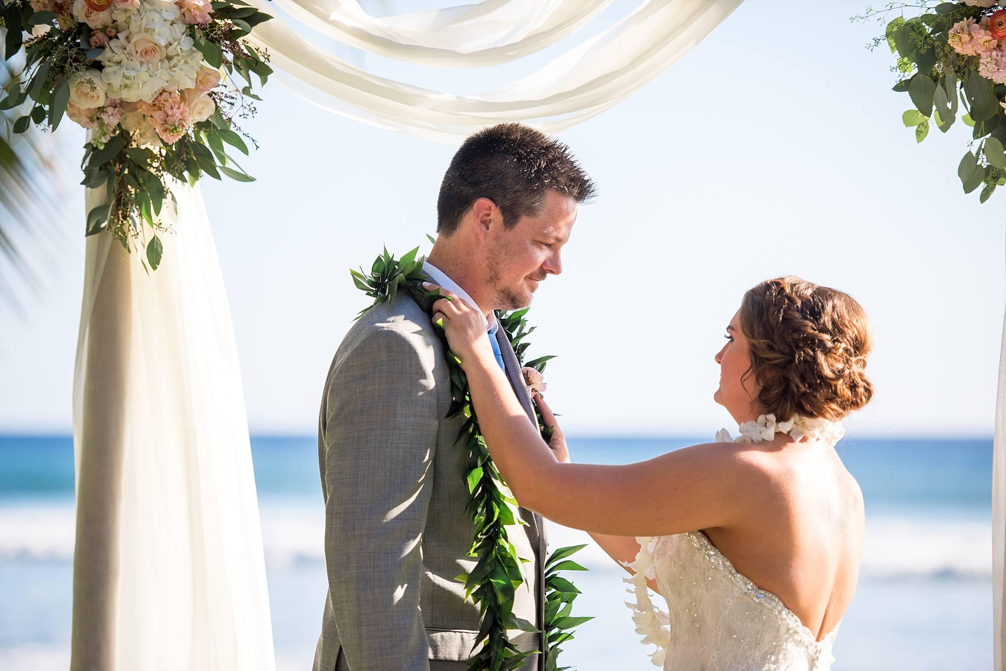 couple exchanging leis at their wedding