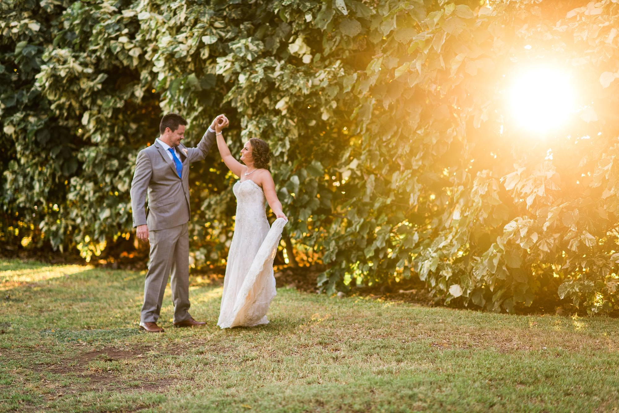 wedding couple dancing on the grass