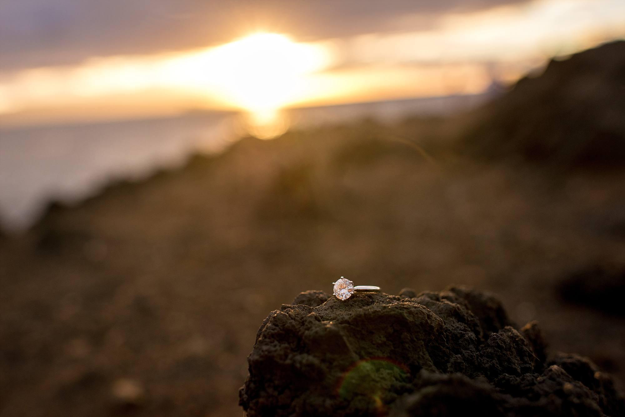 diamond solitaire sitting on lava rock