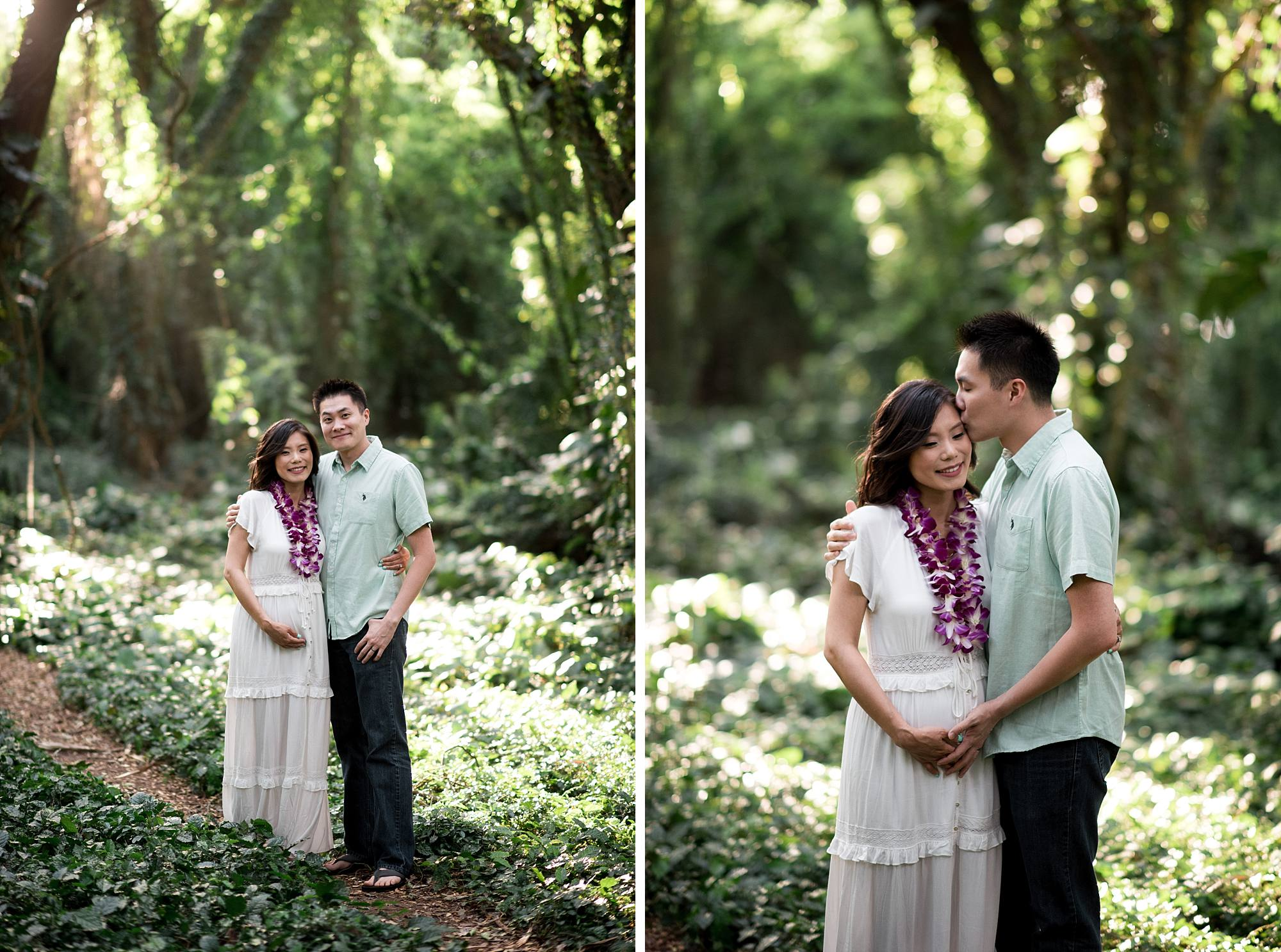 Maternity photos in Honolua Jungle husband and wife touching belly