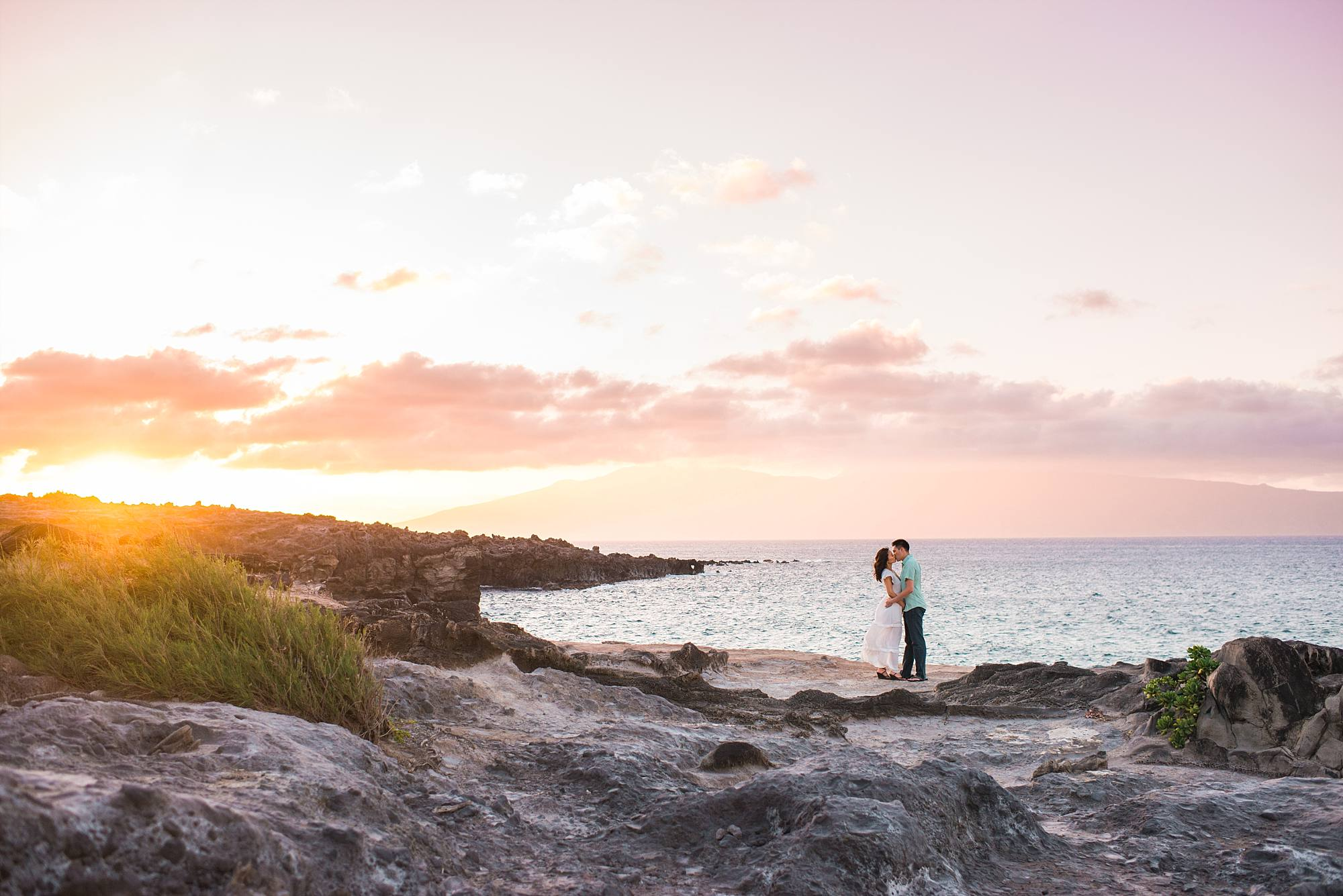kissing parents-to-be on the cliffs of honolua