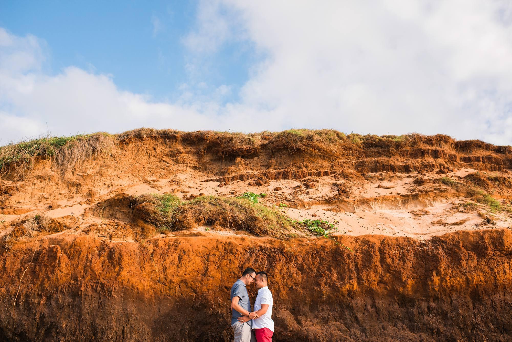 engagement photo of incredible Maui rockwall