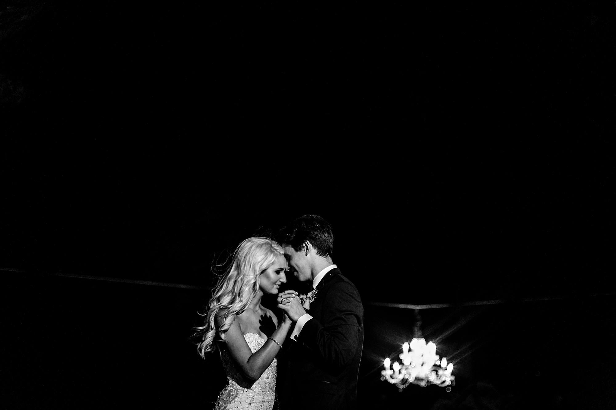 happy bride and groom dancing in the night