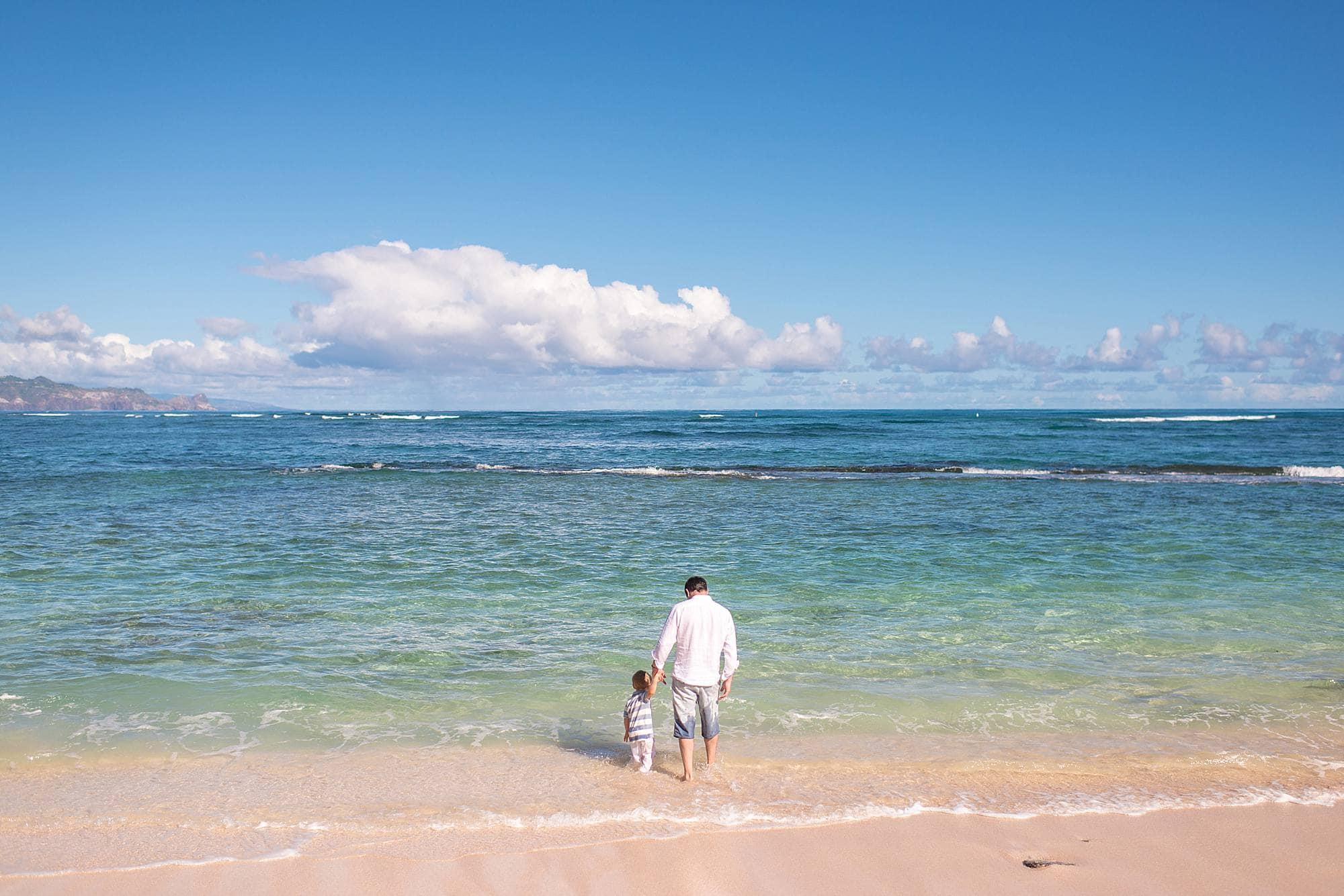 father and son on beach in maui, hawaii