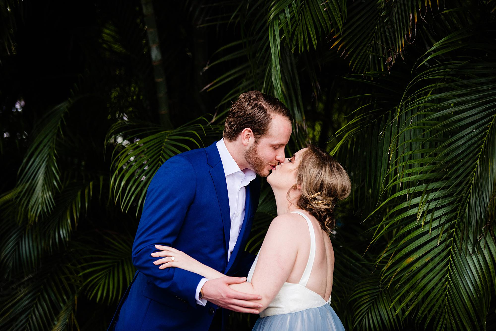 couple kissing after first look