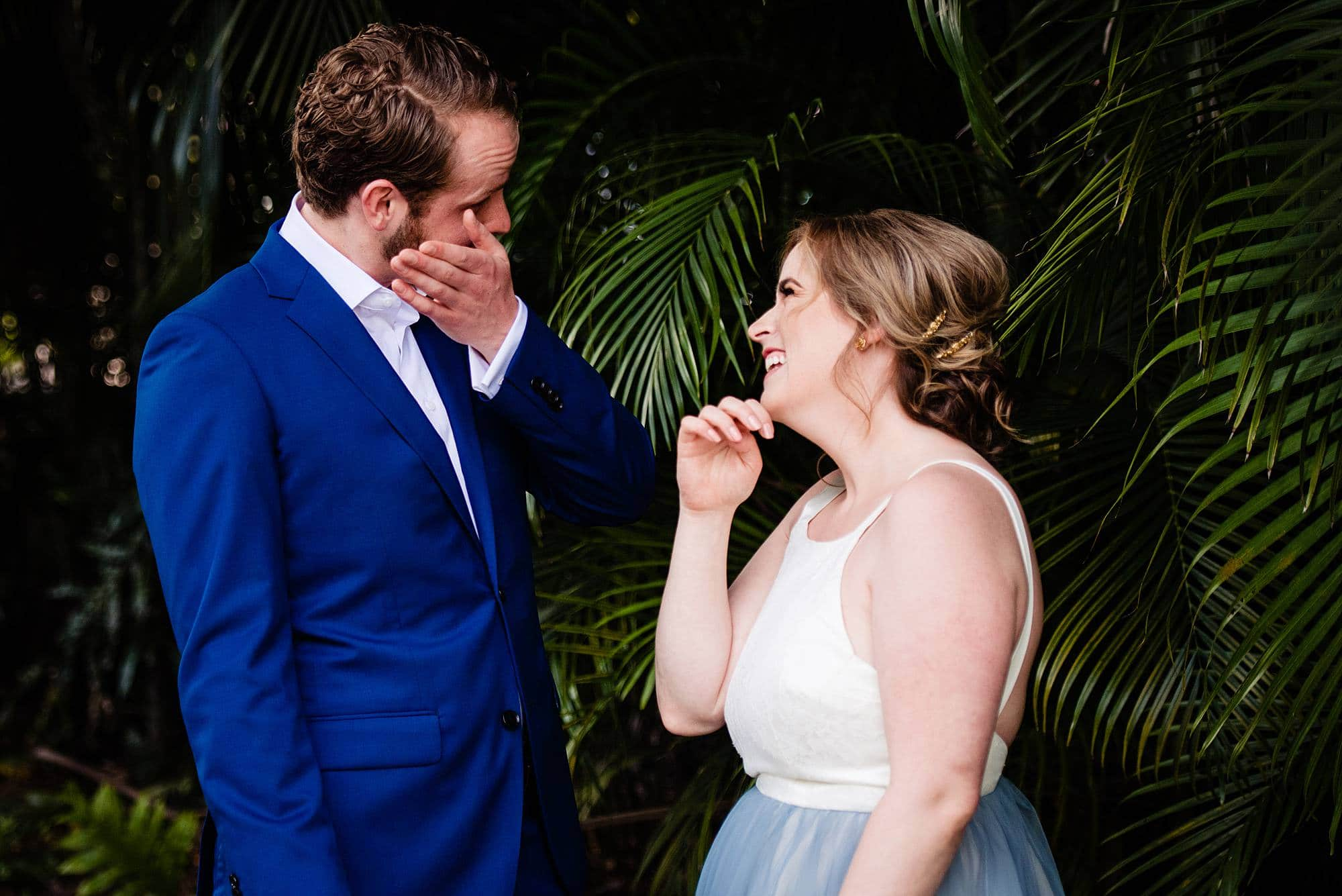 couple laughing after first look