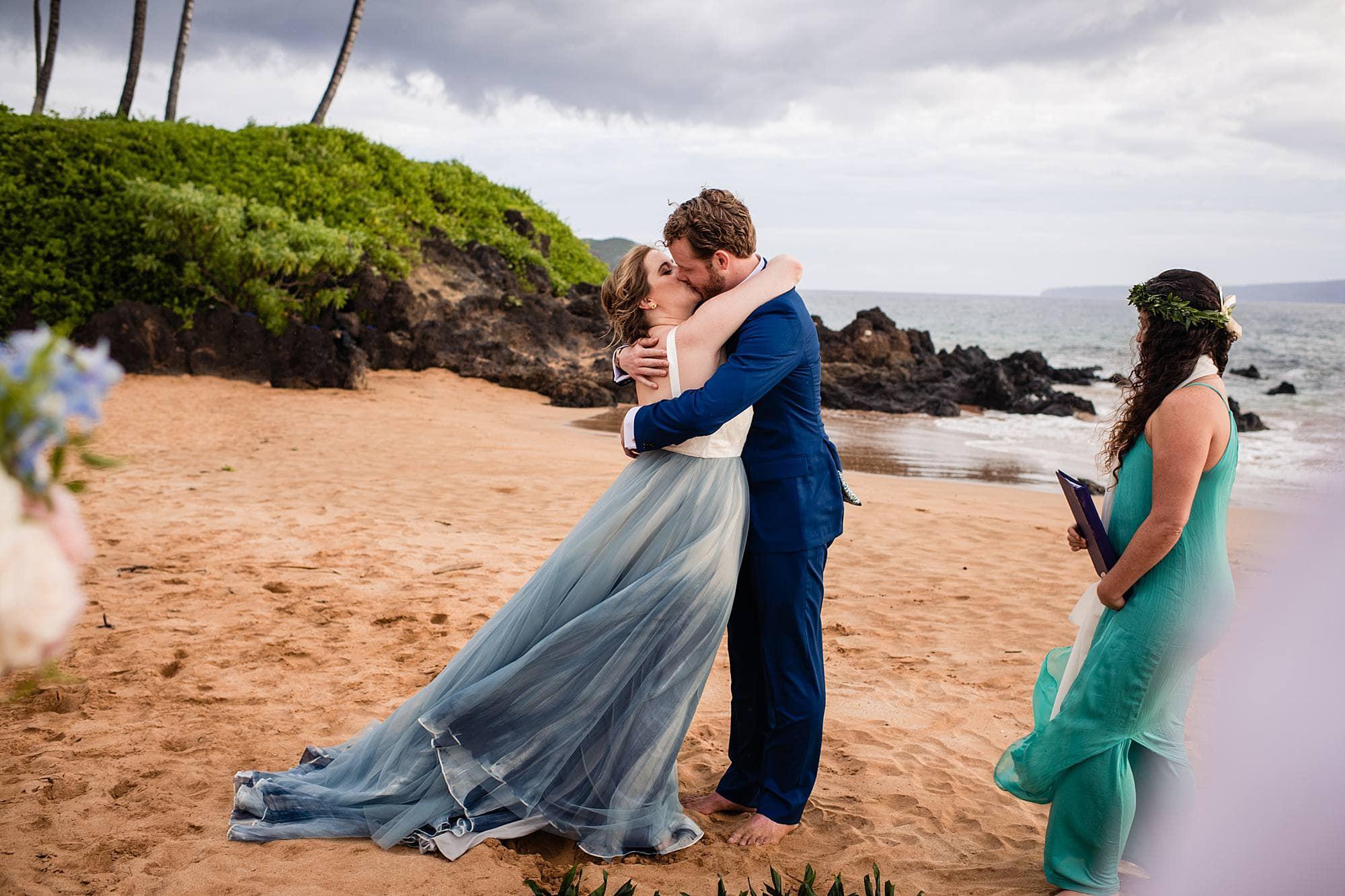 first kiss at beach wedding