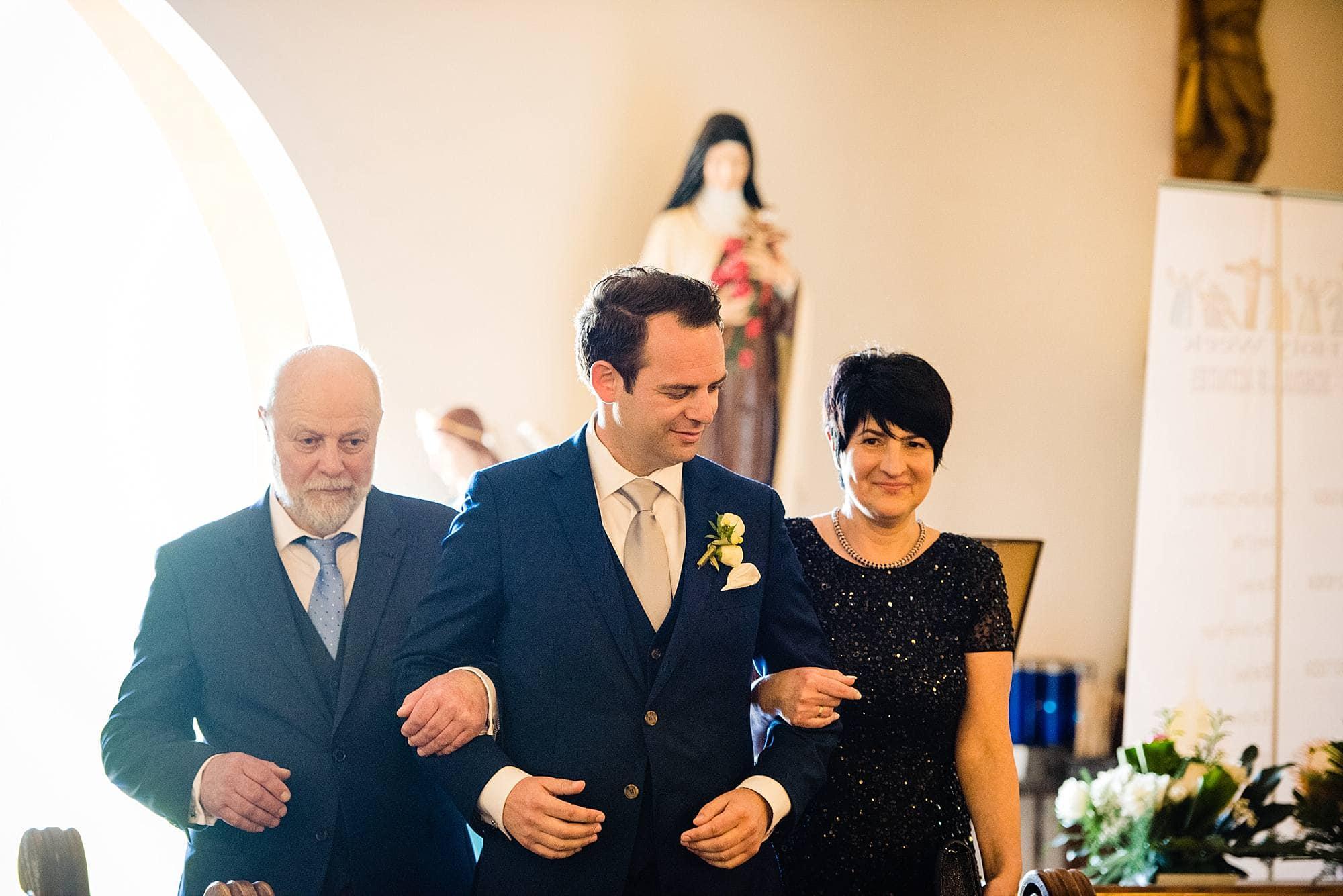 groom walking parents in church in makawao