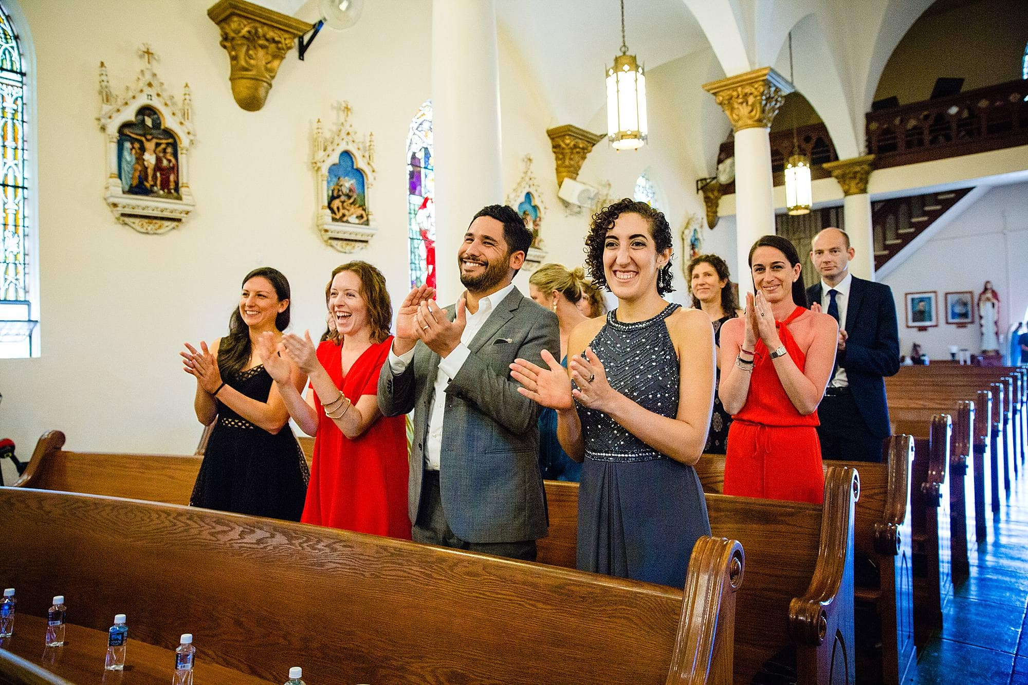 guests clapping at church wedding in maui