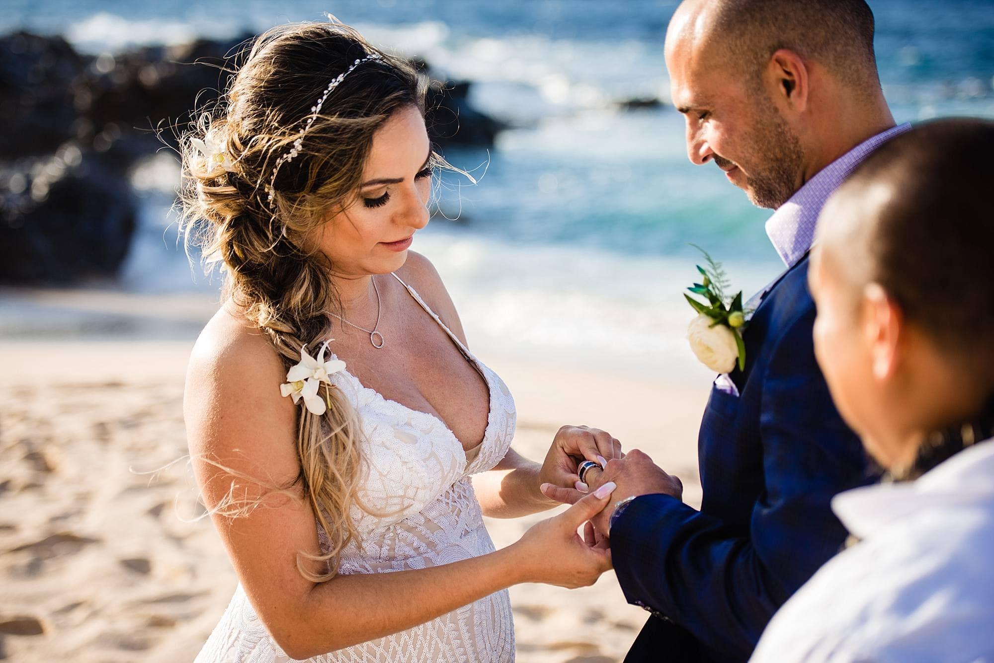 bride placing ring on finger