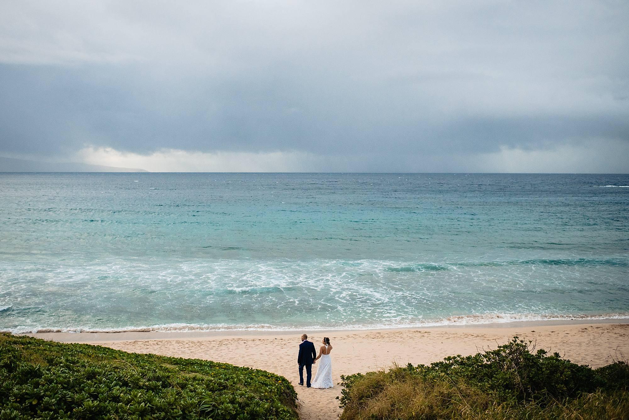 oneloa beach wedding with bride and groom