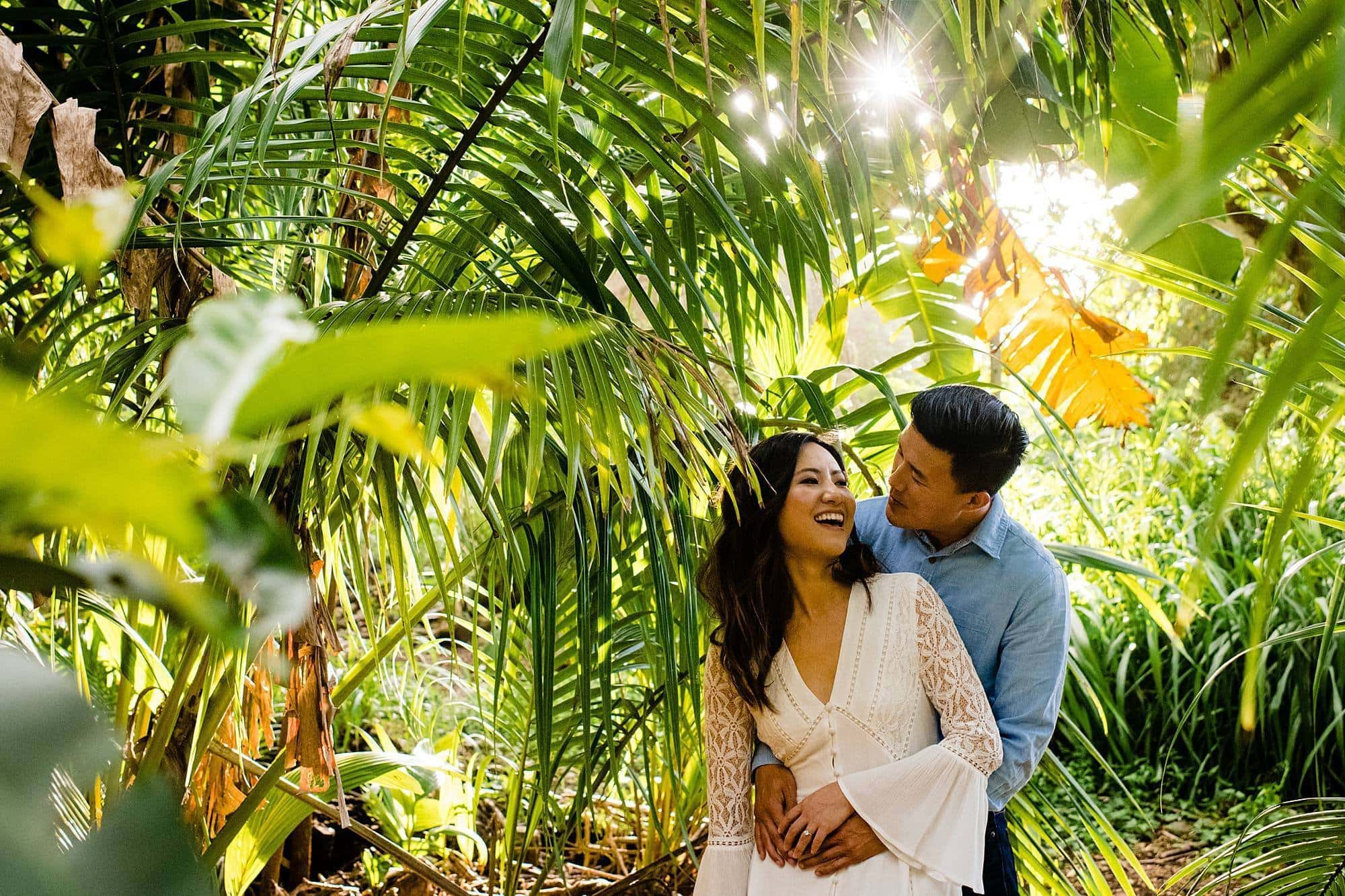 couple cuddling in the jungle