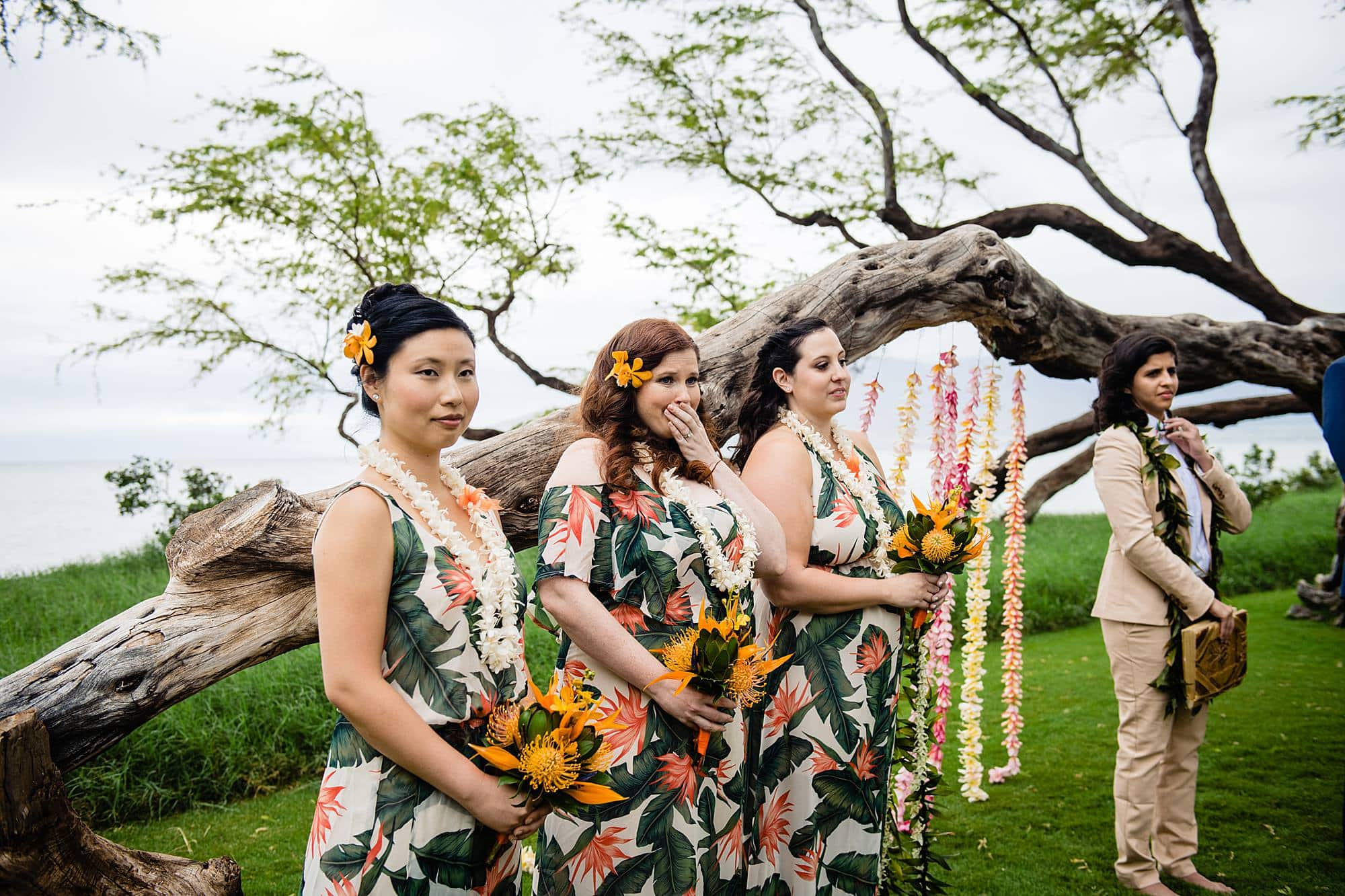 bridesmaids seeing frind walk down the aisle