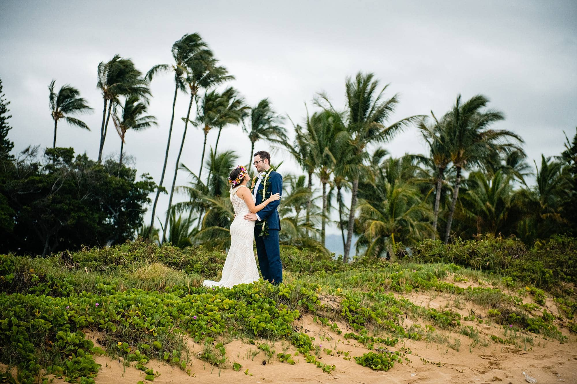 bride and groom with palm trees in north kihei