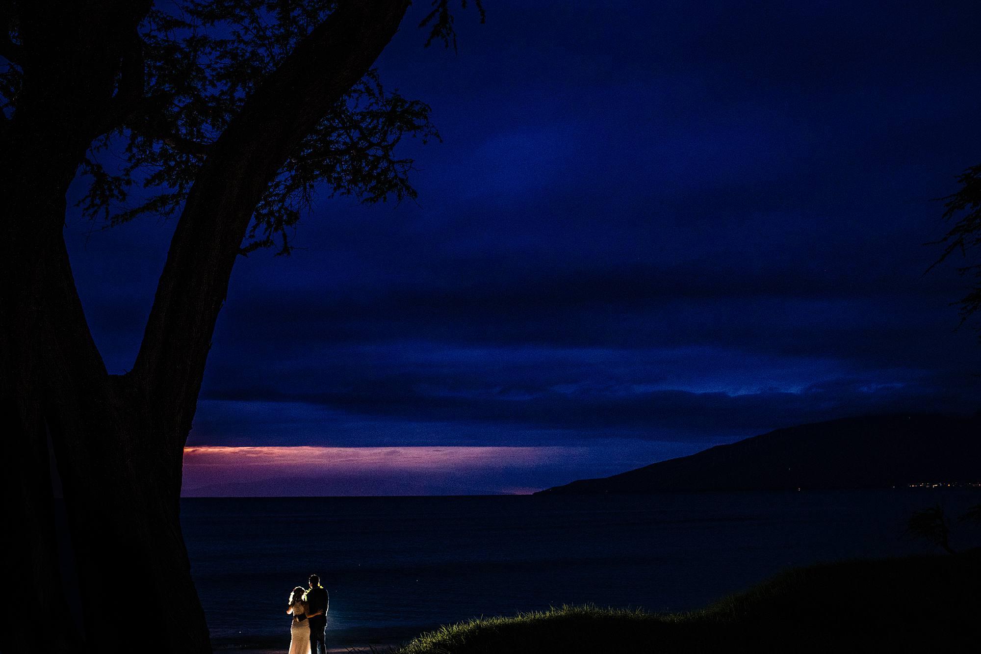 sunset in kihei hawaii with bride and groom