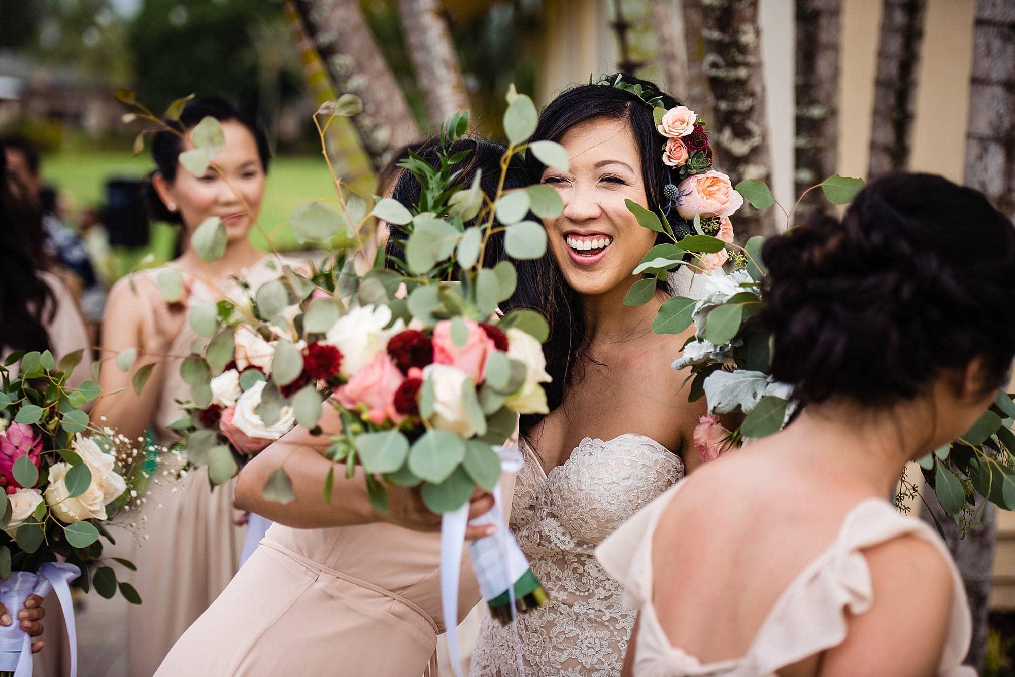 bride hugging bridesmaid Steeple House Kapalua