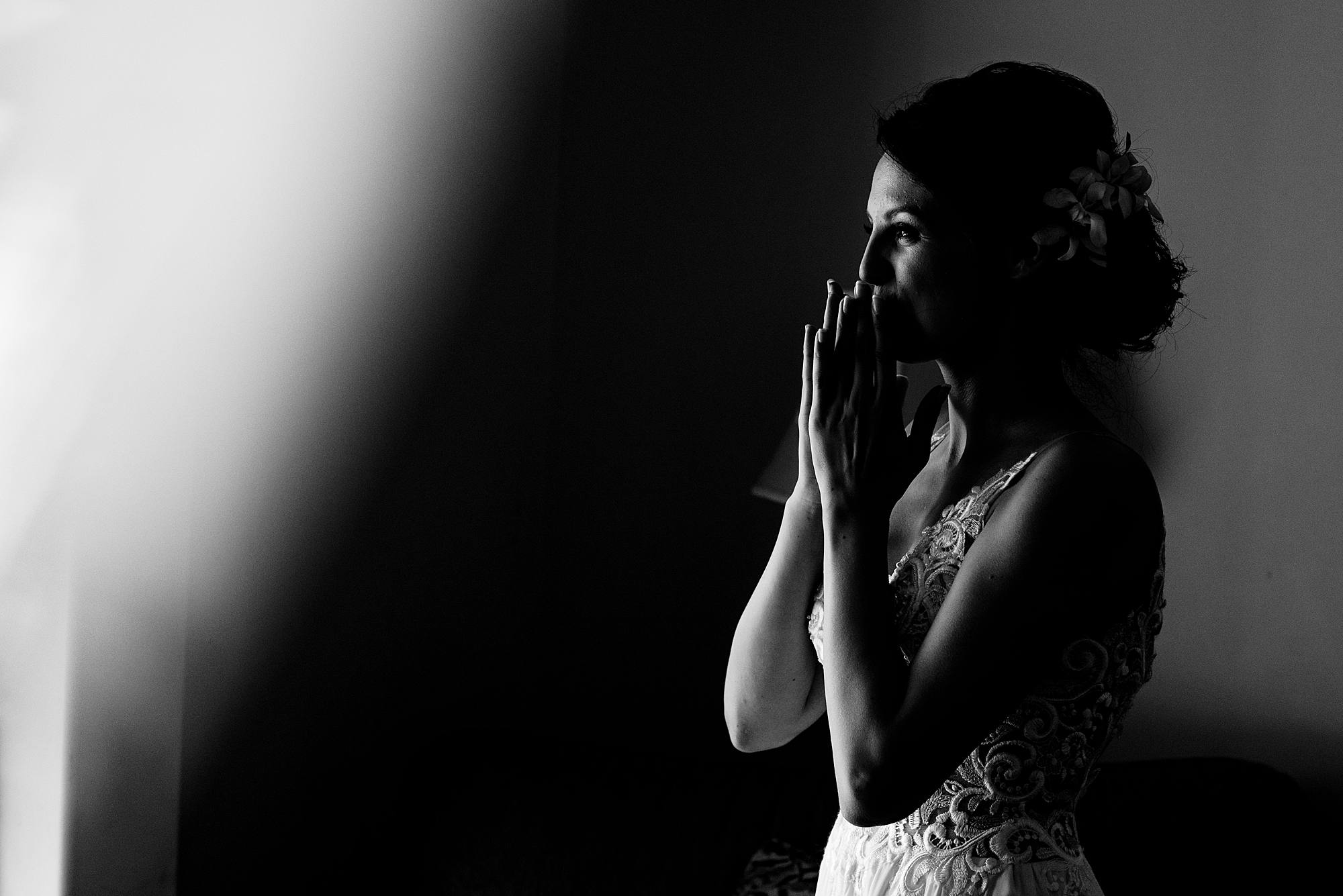 black and white image of bride blowing a kiss