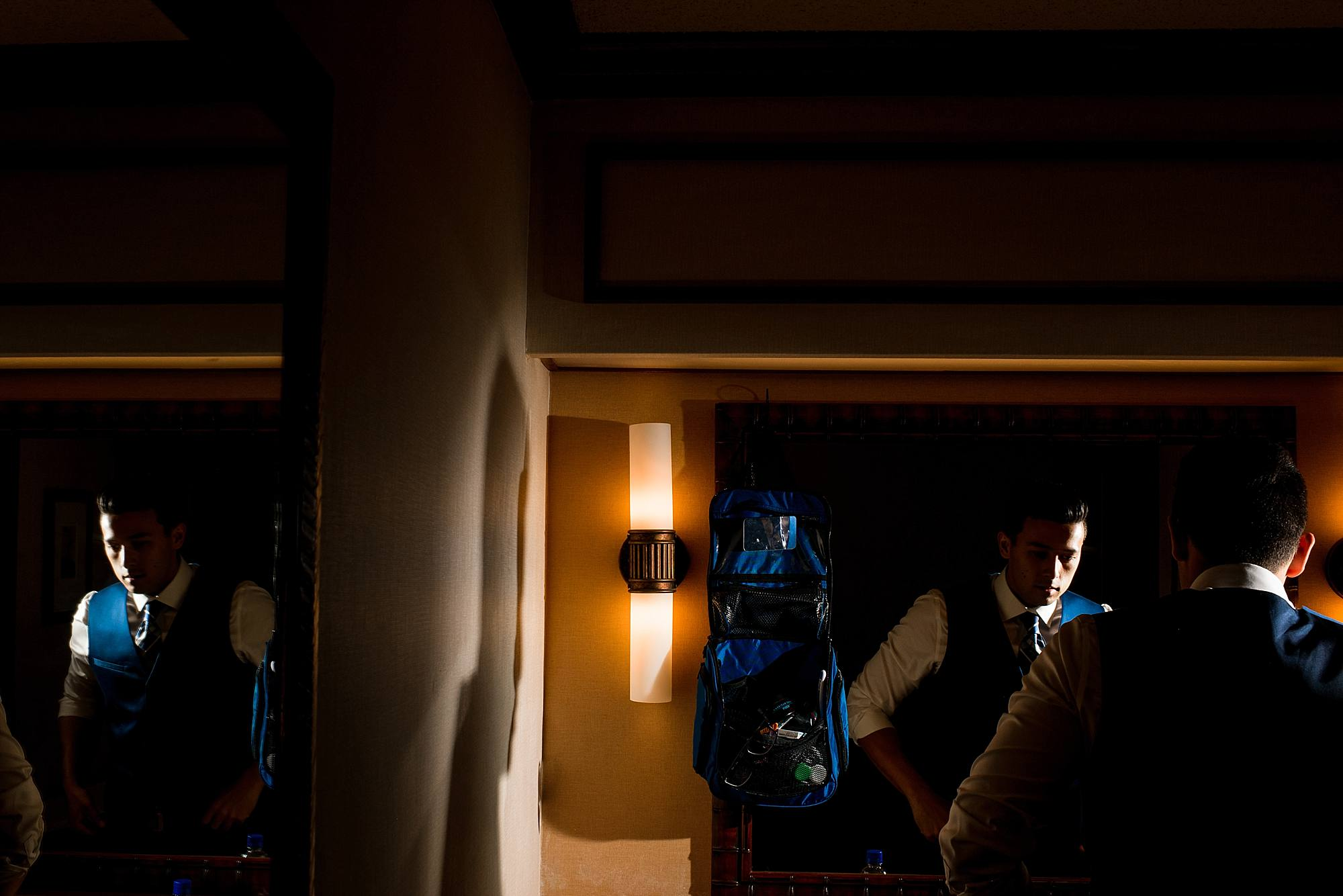 groom getting ready in hotel room