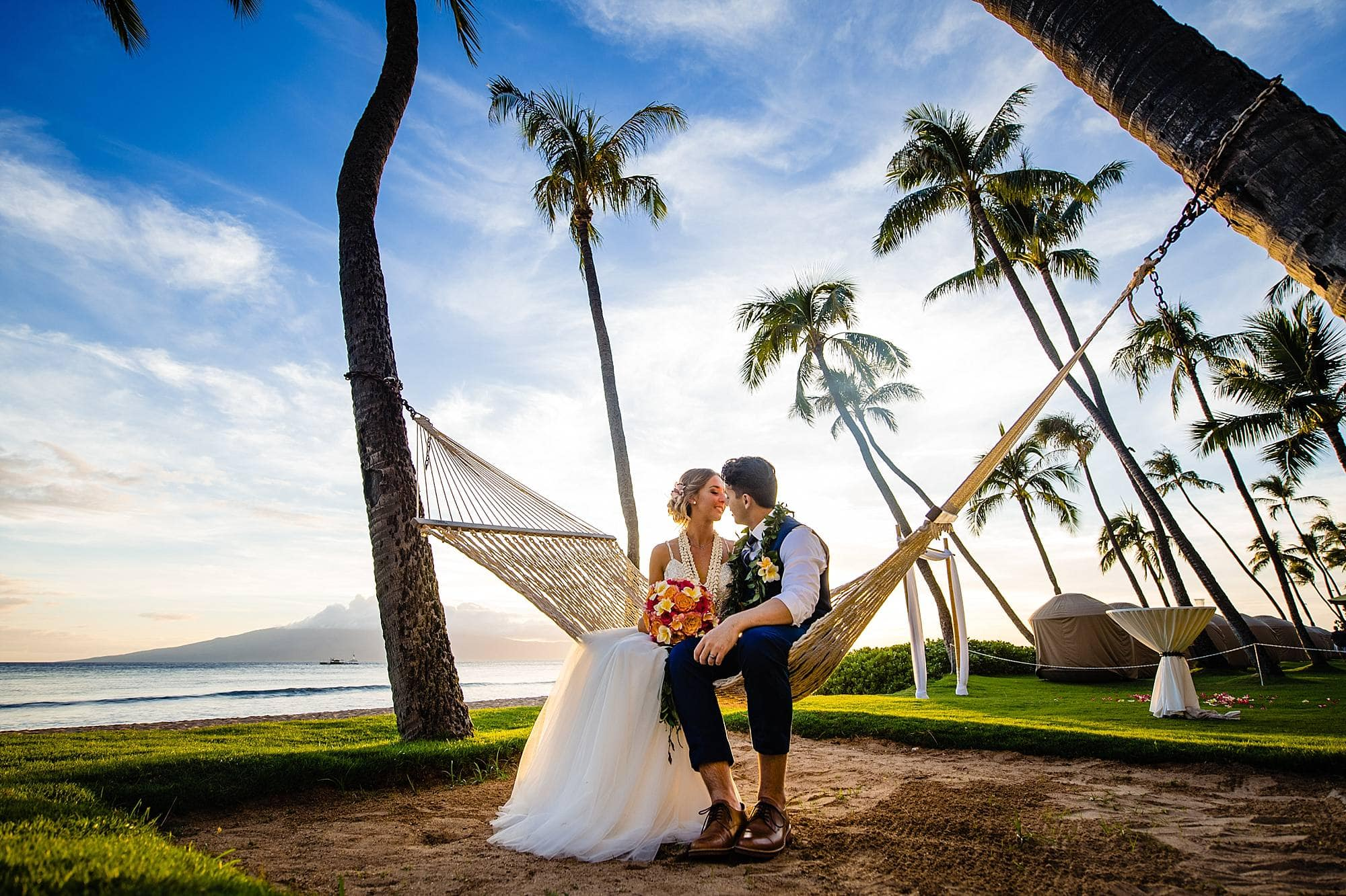 bride and groom in hammock at hyatt maui