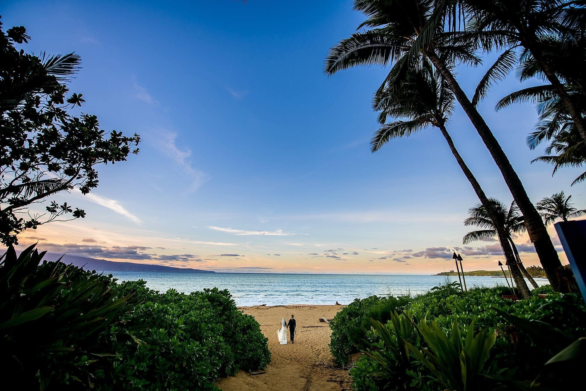 bride and groom on beach in maui