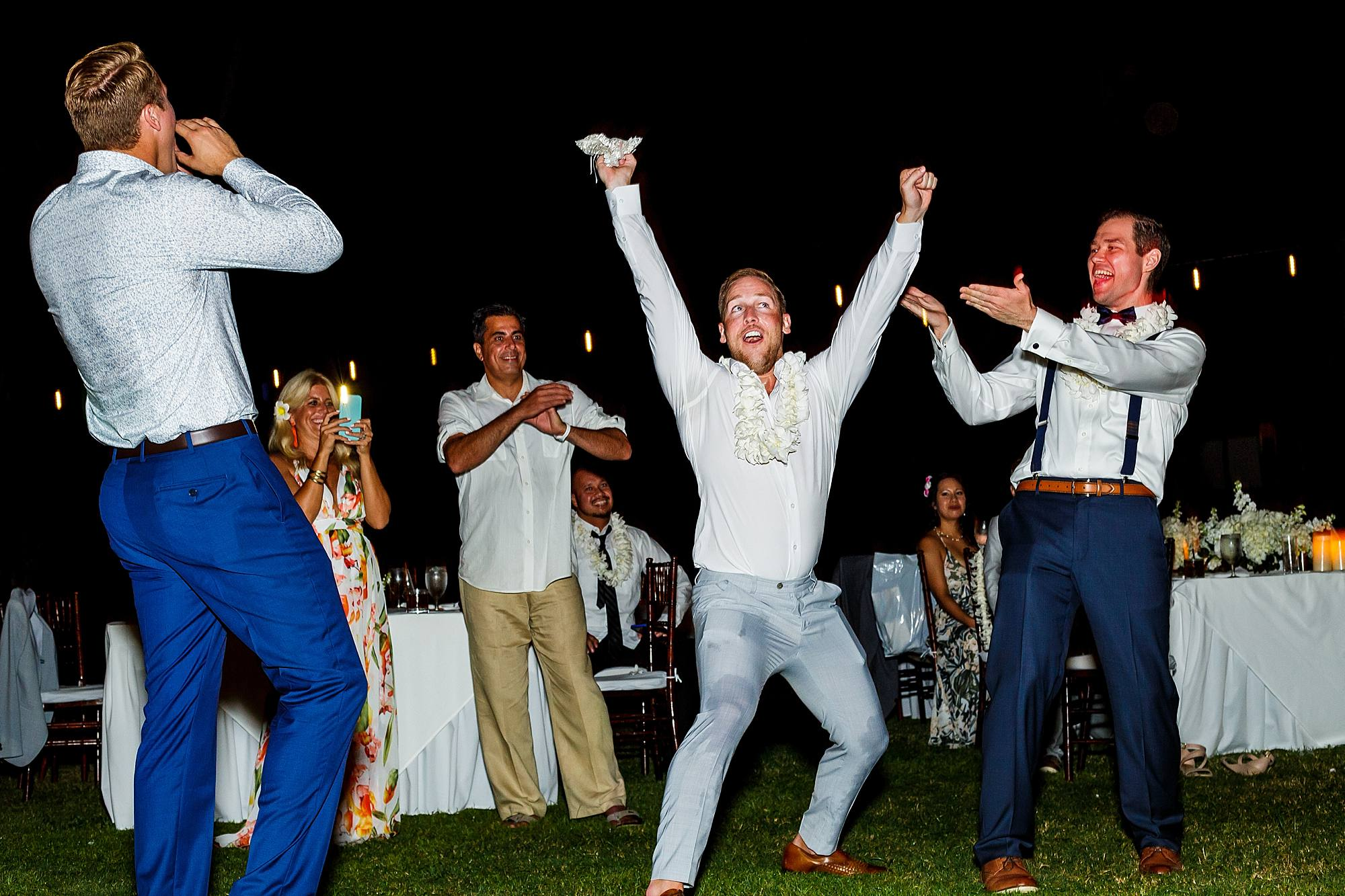 excited guest during garter toss