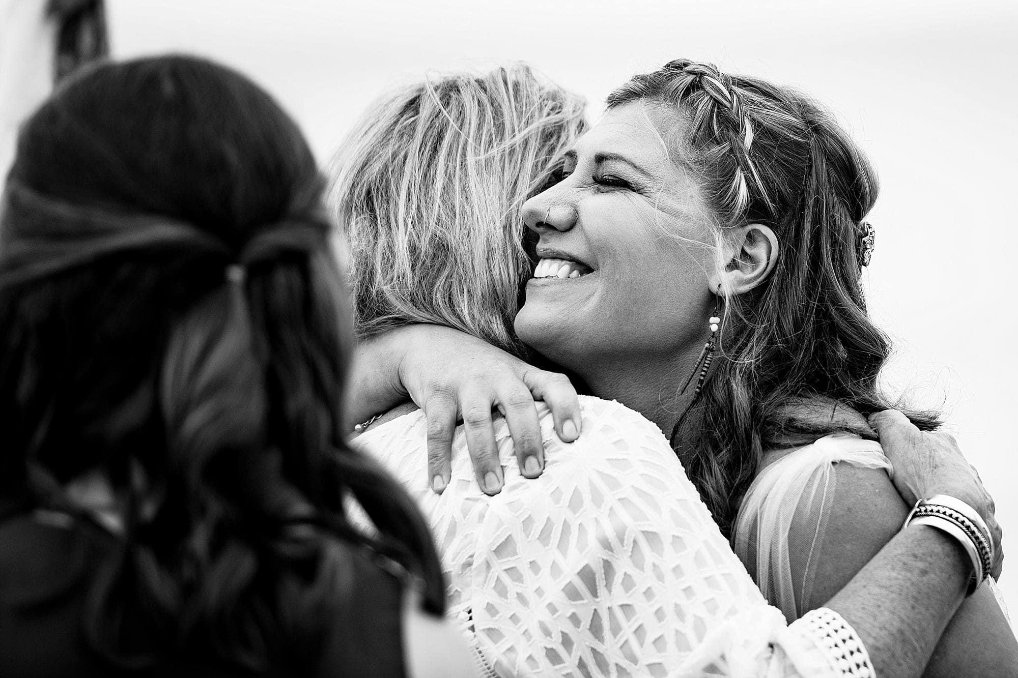 bride hugging her mom before wedding