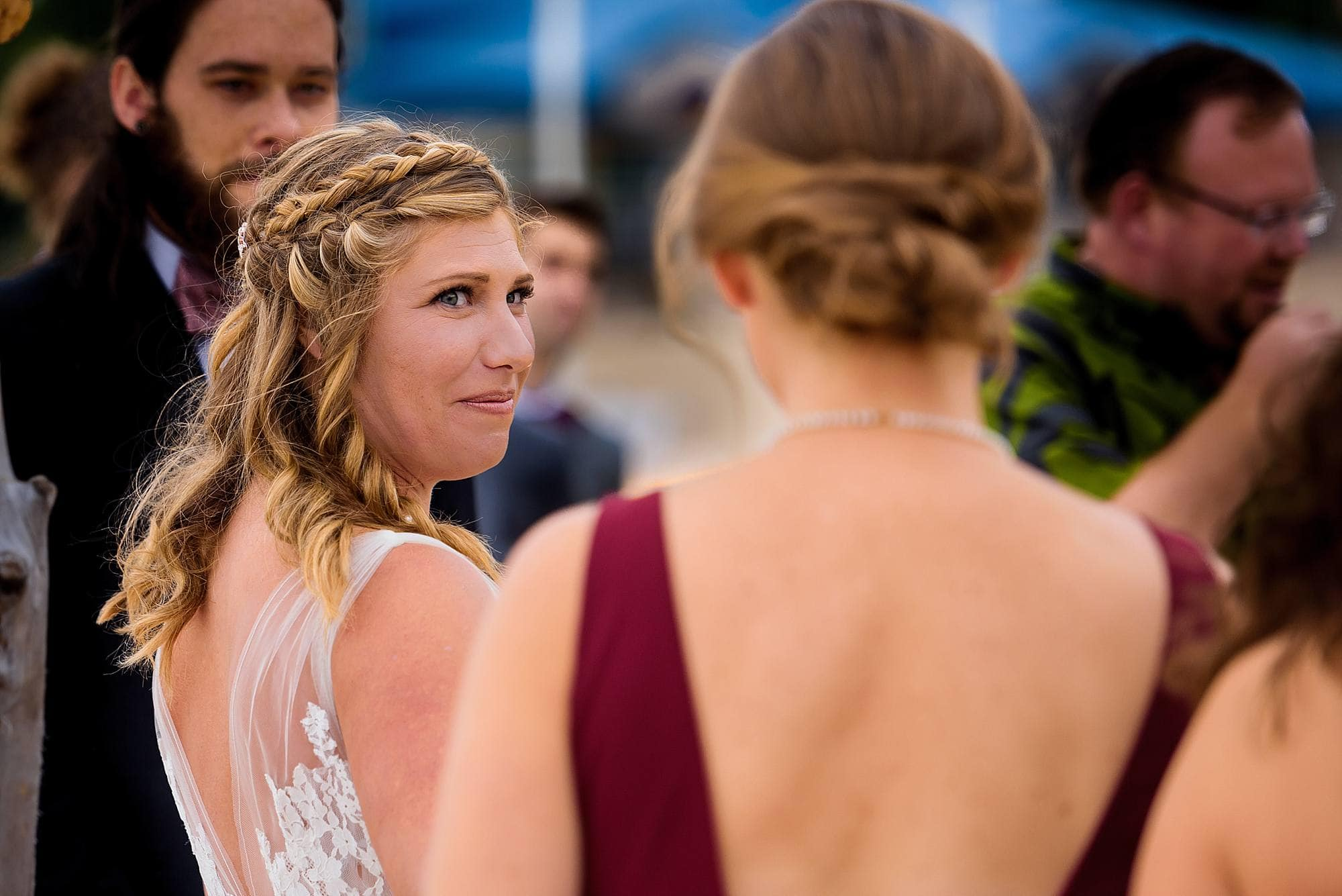 bride looking at maid of honor during wedding