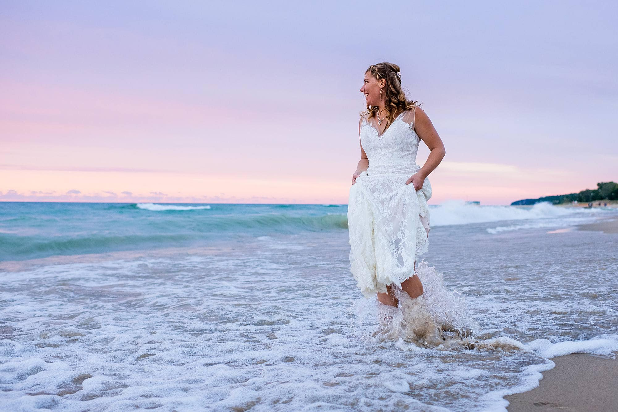 bride in lake michigan shorebreak