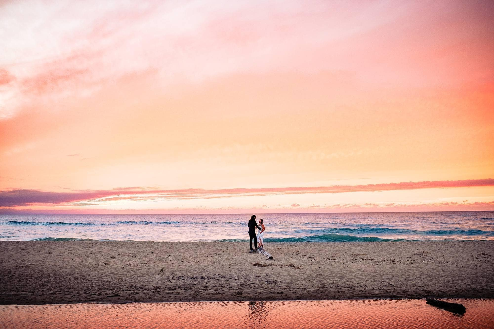 sunset at warren dunes state park with bride and groom