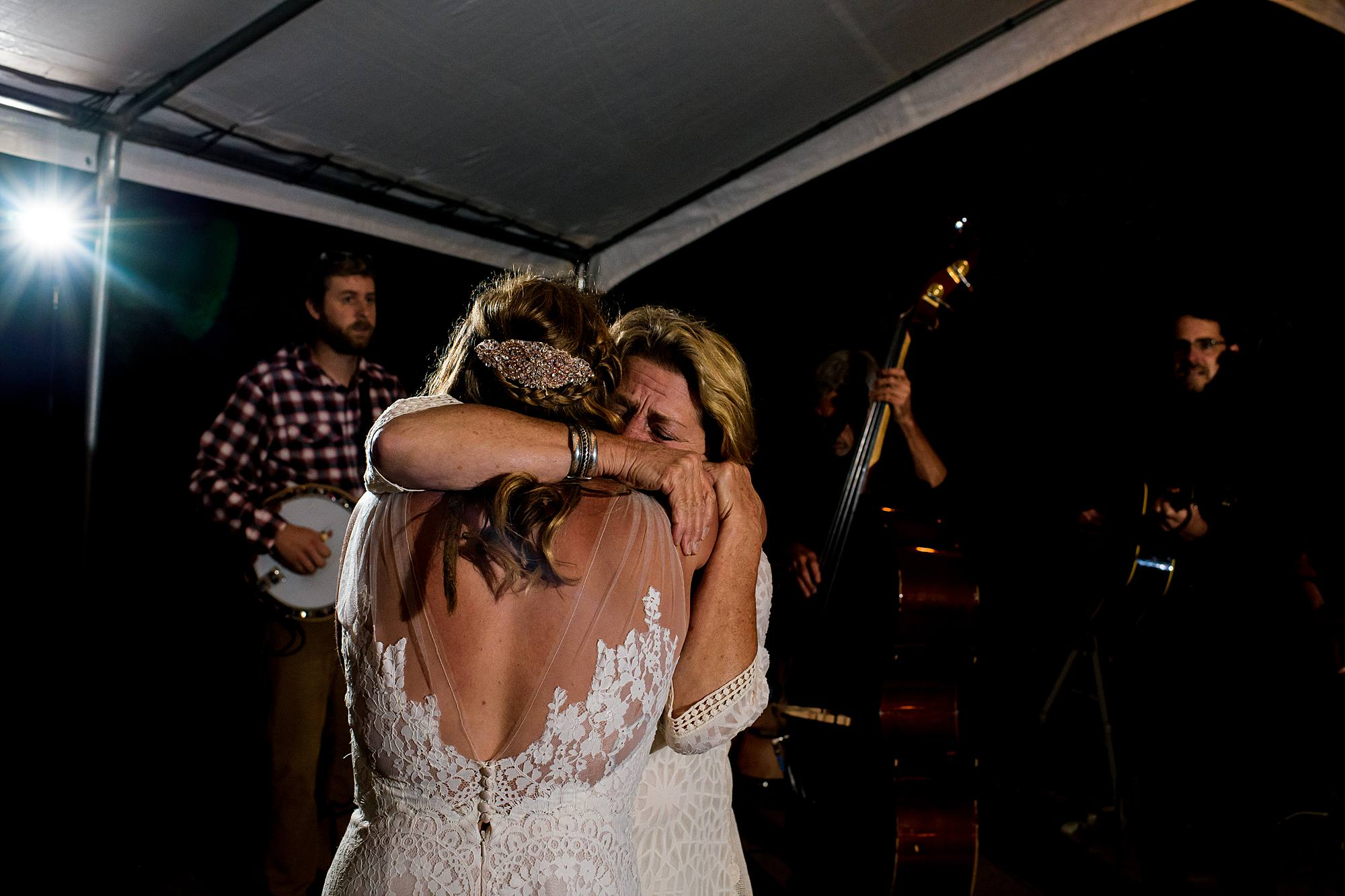 mom and bride hug at west michigan wedding reception