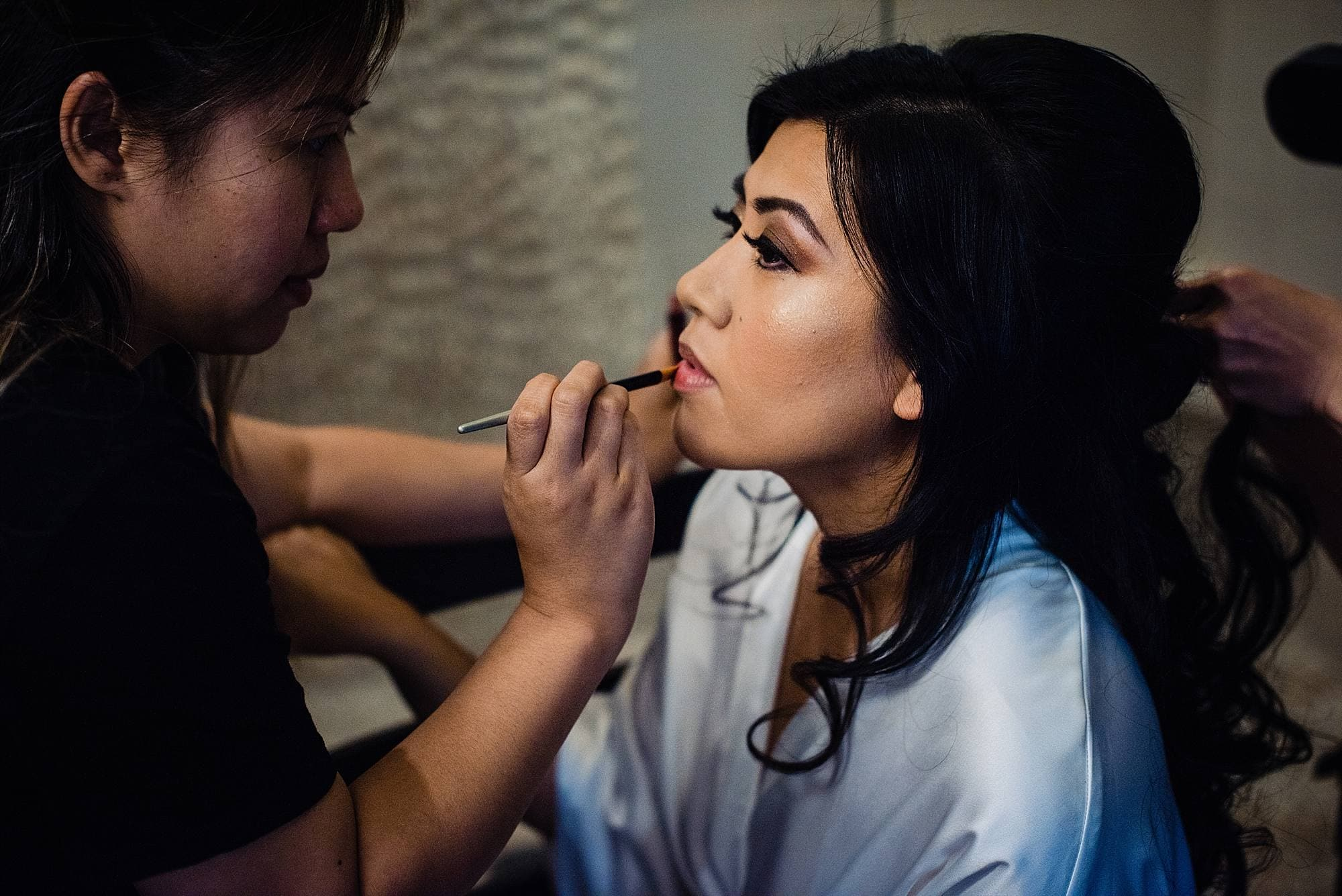 bride getting her makeup done before maui wedding