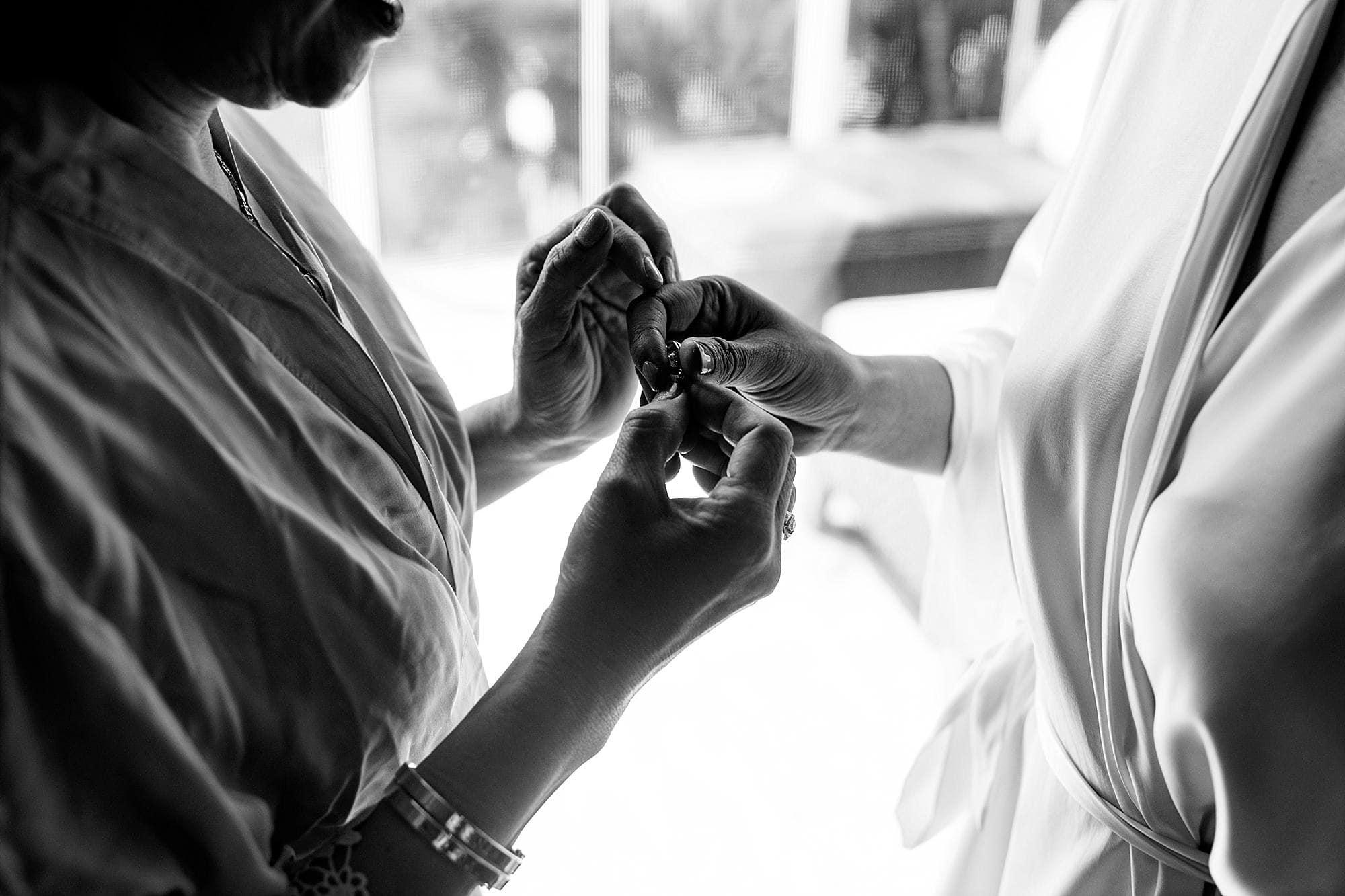 bride's mother helping bride get ready