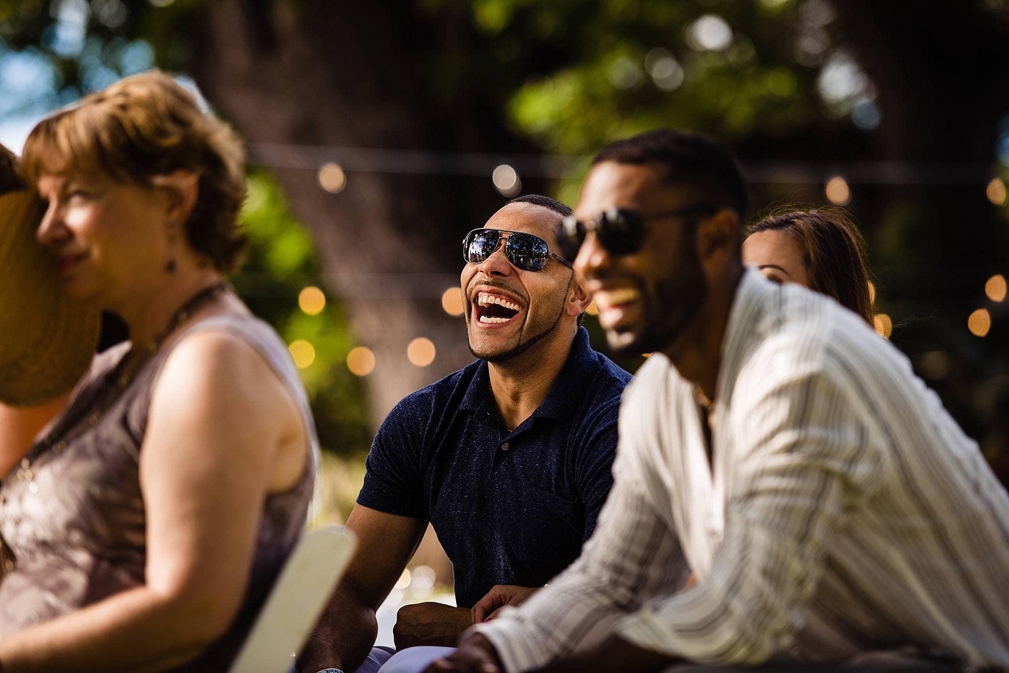 guests laughing at olowalu plantation house wedding