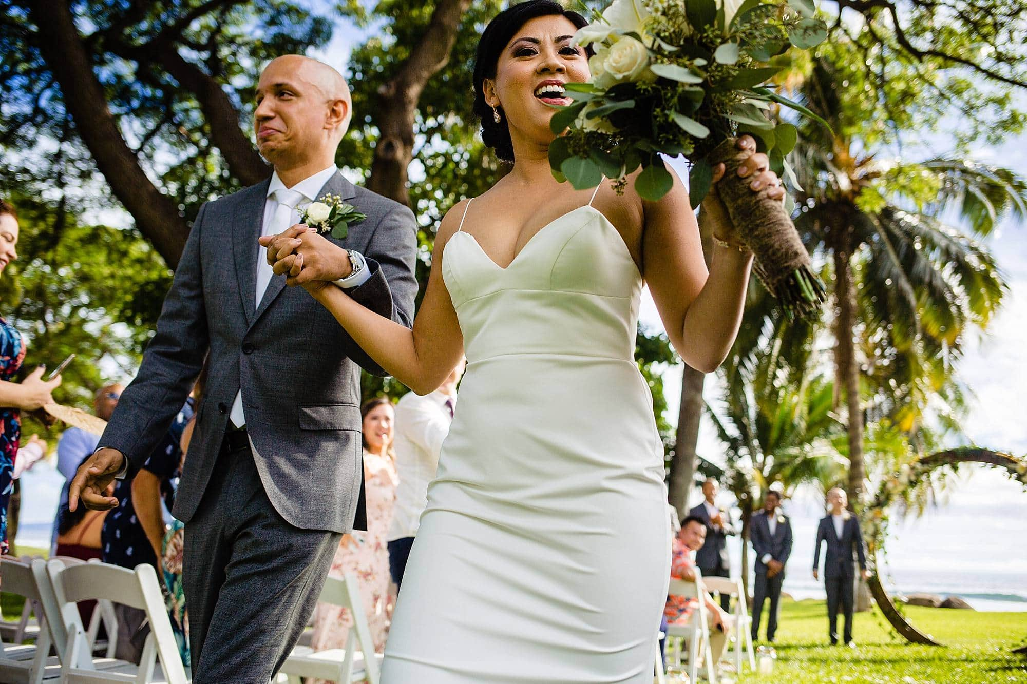 bride and the groom celebrating after getting married at olowalu plantation house