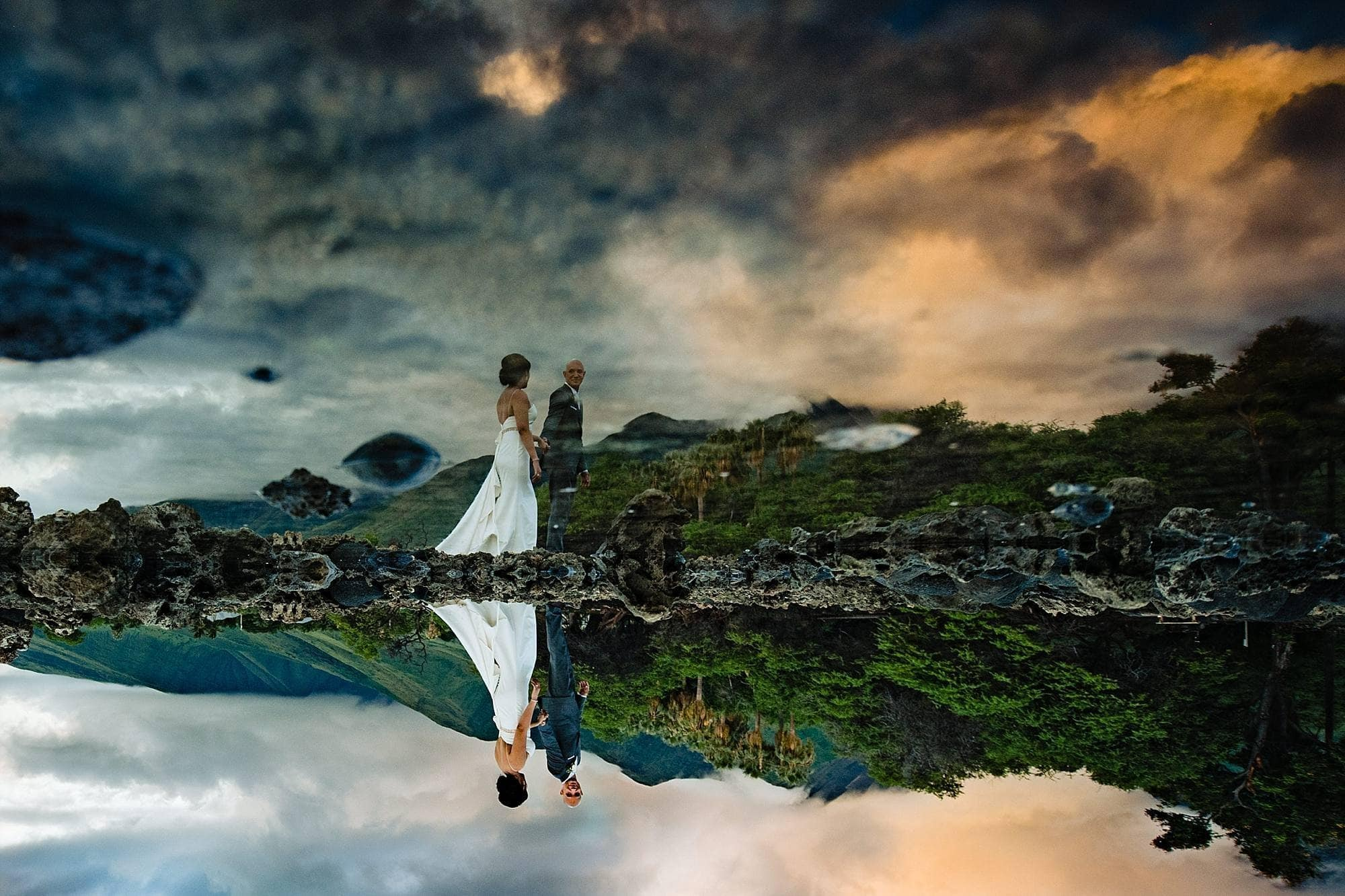 bride and groom water reflection at olowalu plantation house