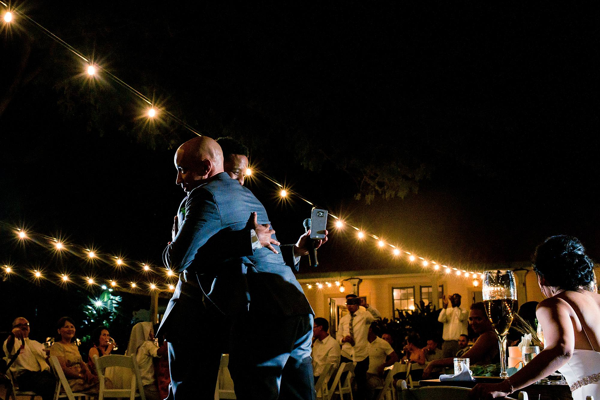 best man and groom hug after speech at olowalu plantation house